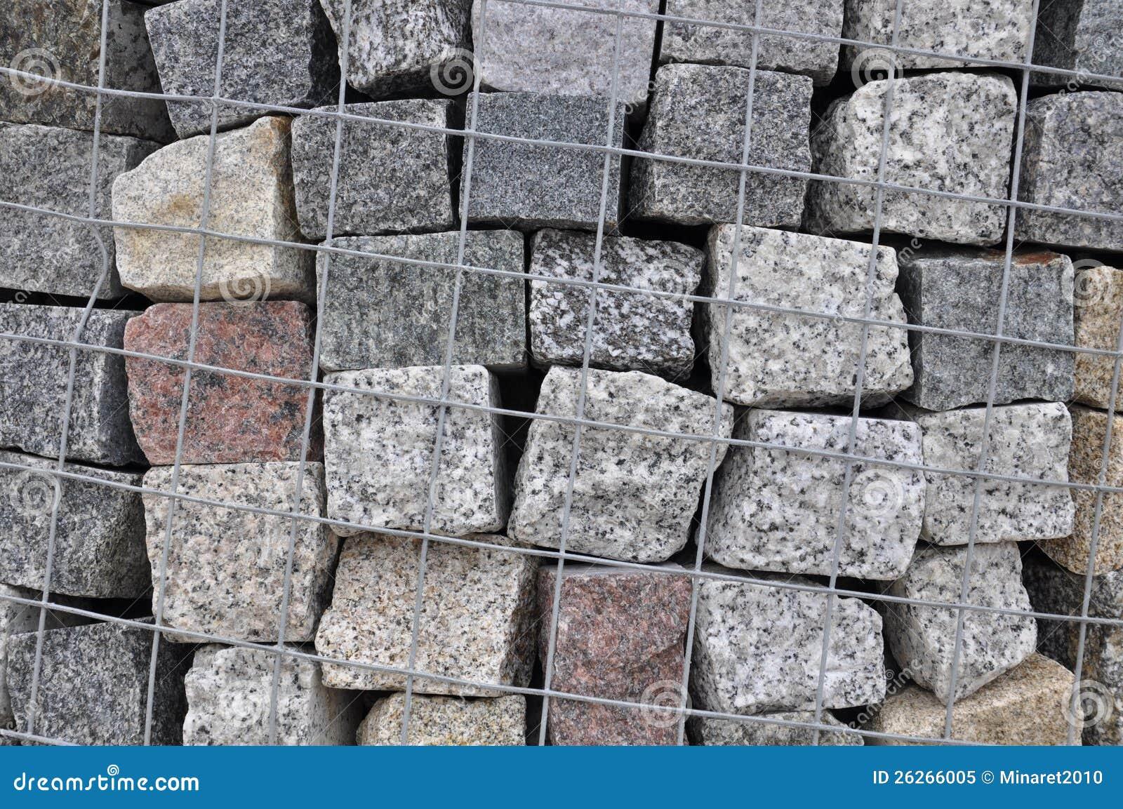 Каменные вымощая камни гранита в containe