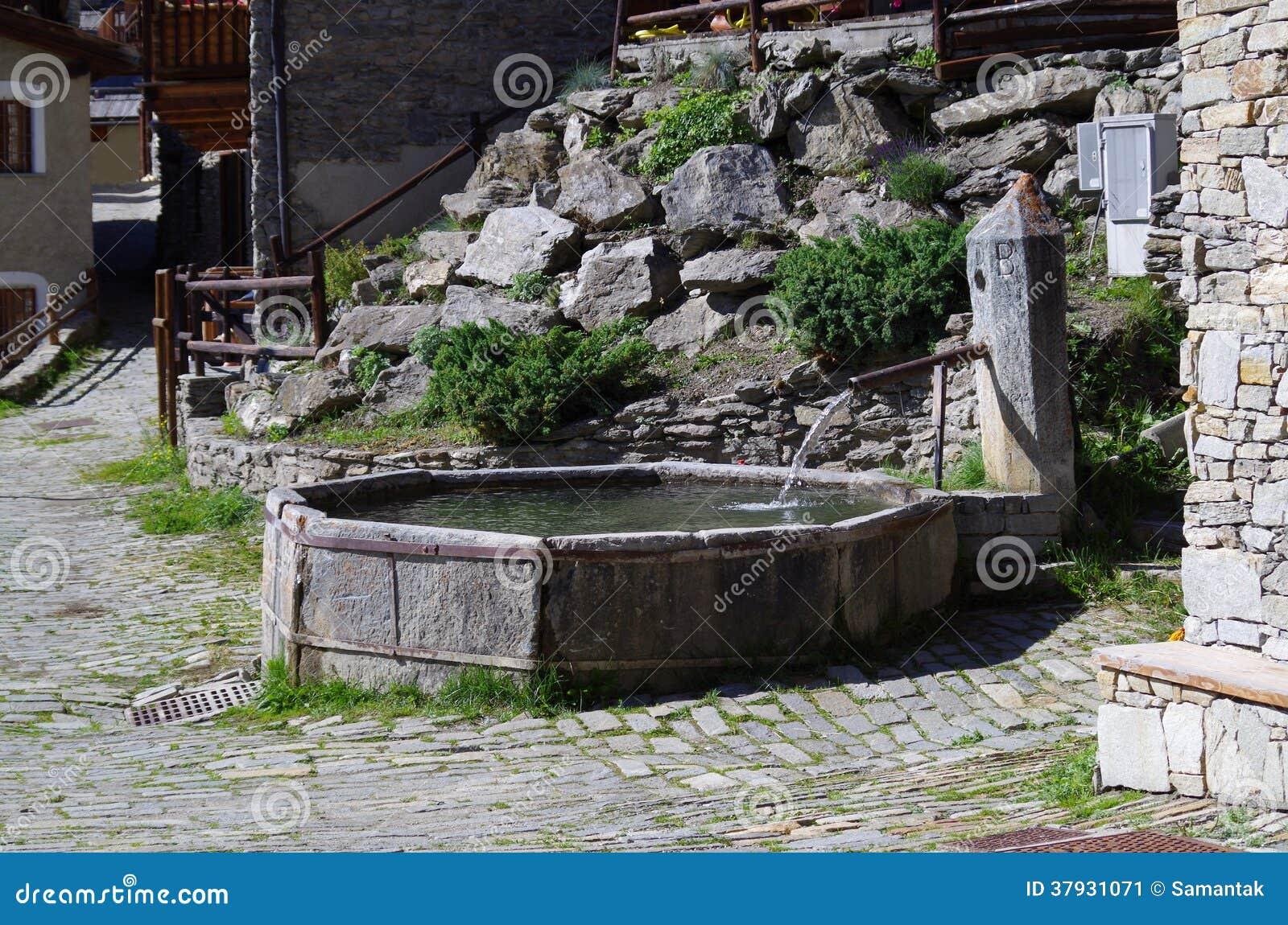 Каменный фонтан в горном селе