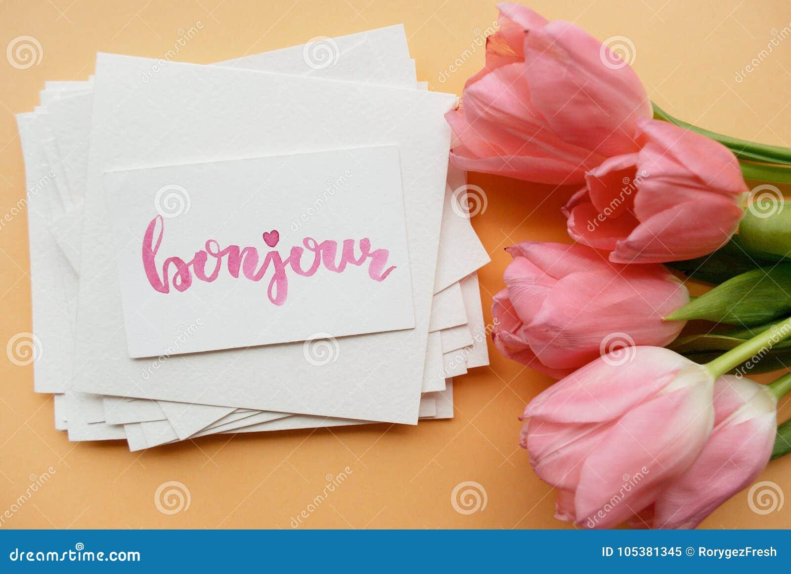 карточка при Bonjour слова написанное в стиле каллиграфии
