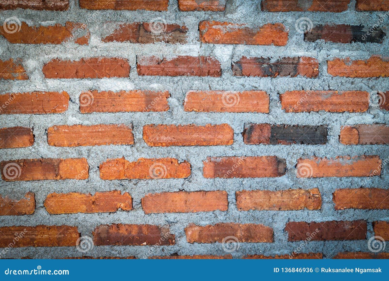Кирпичная стена предпосылки текстуры красного цвета
