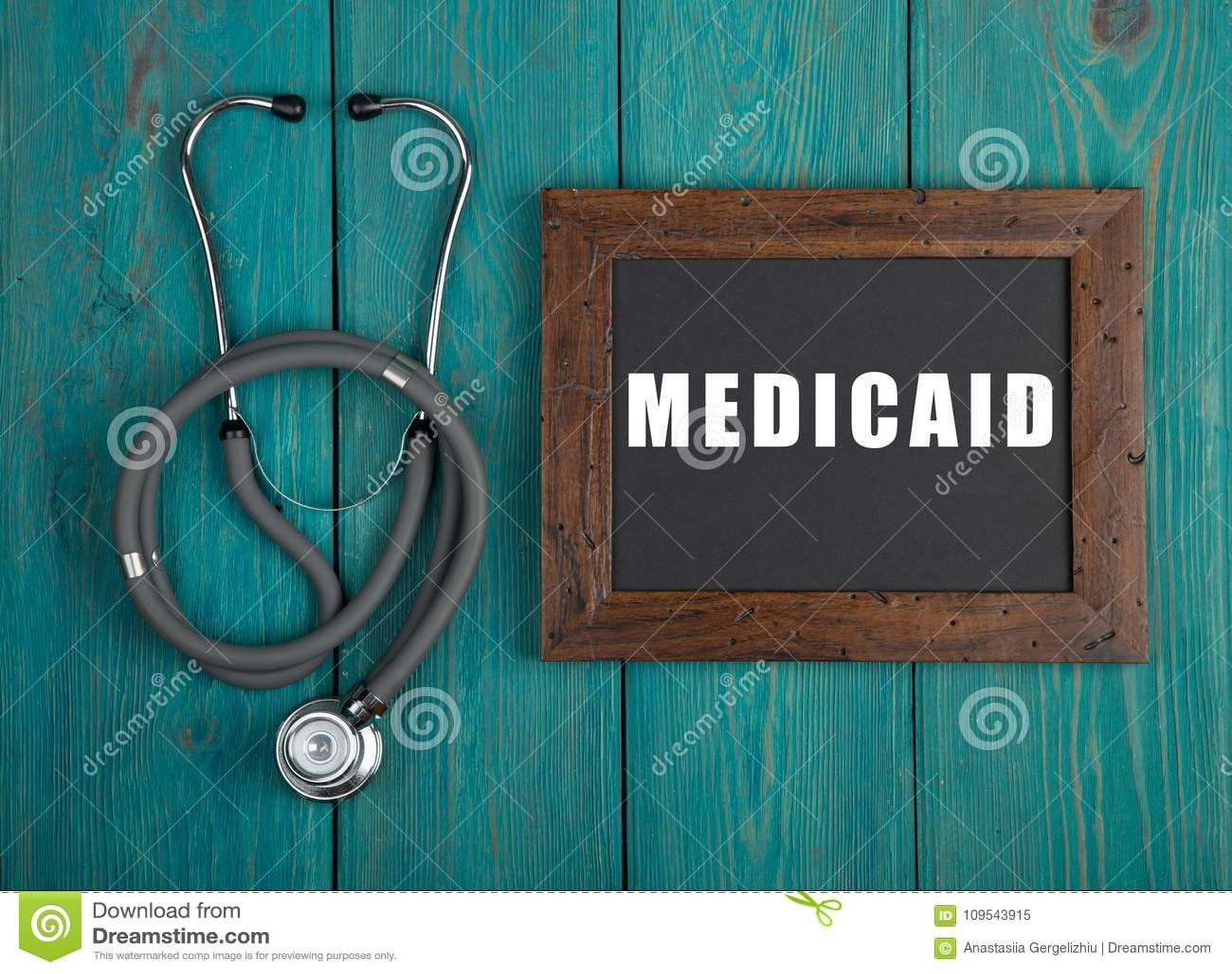Классн классный с текстом & x22; Medicaid& x22; и стетоскоп