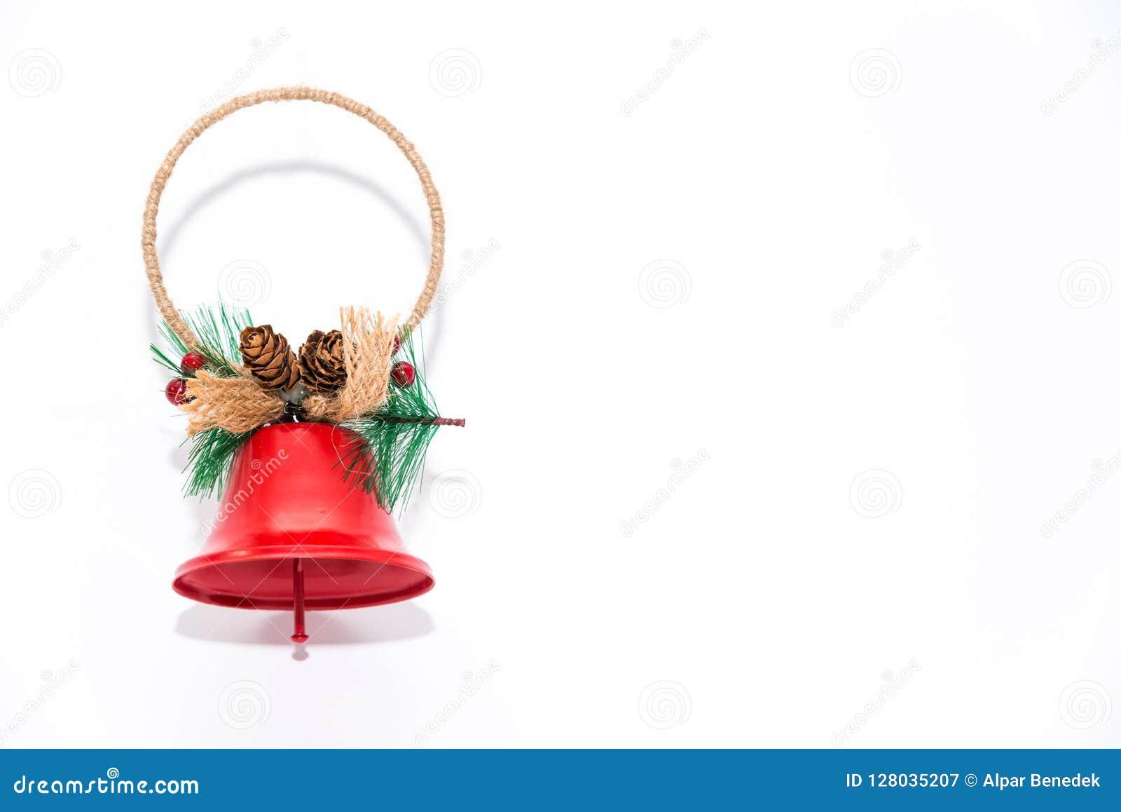 Колокол рождества, конец украшения орнаментов вверх изолированный на белой предпосылке