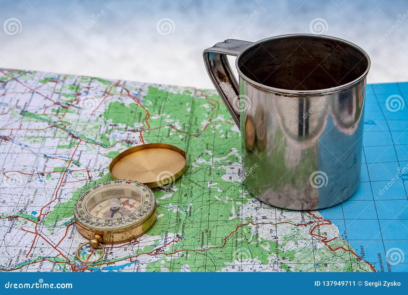 Компас, чашка и туристская карта Украины outdoors