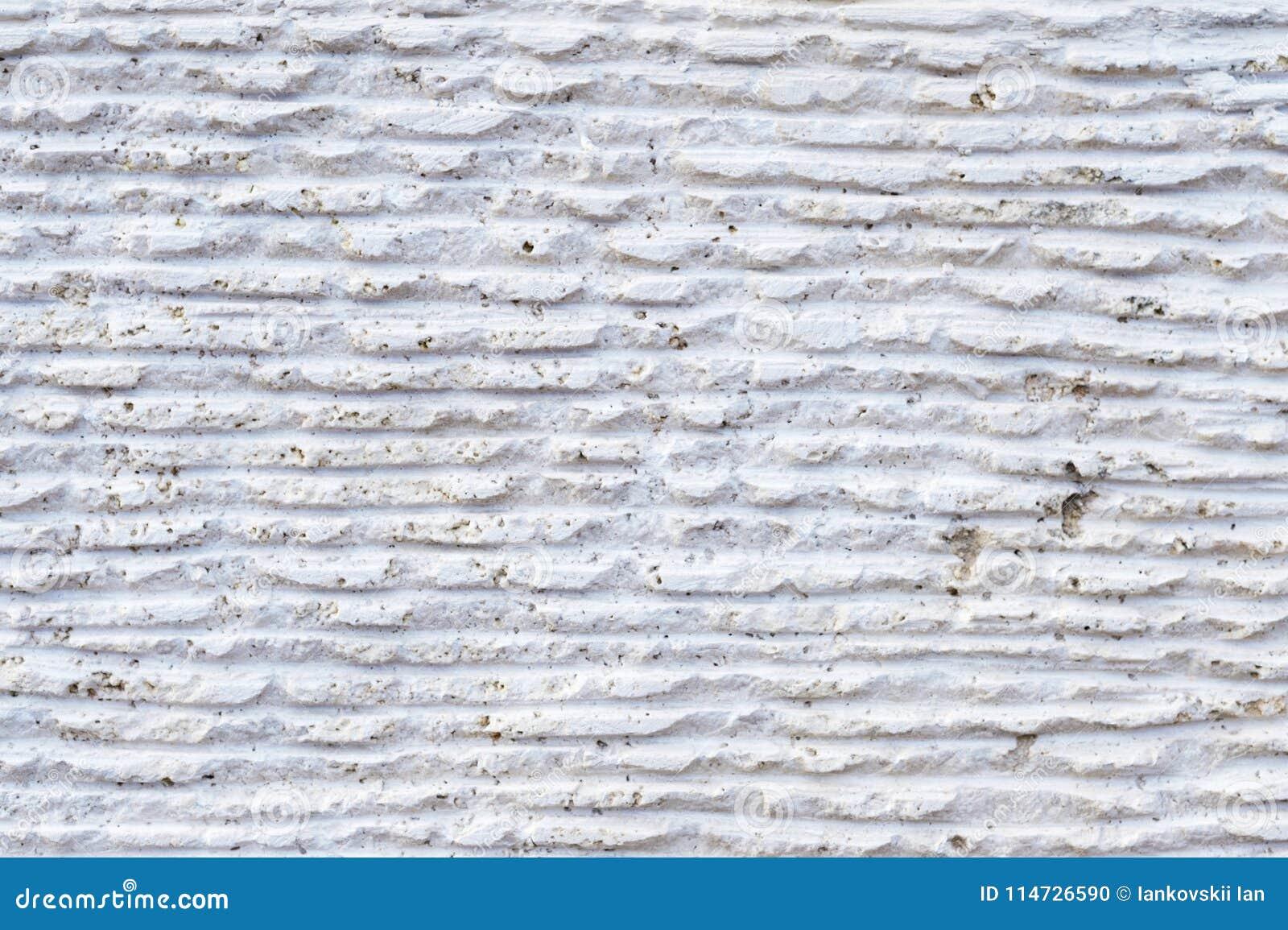 Конец-вверх каменной поверхности с трассировками обрабатывать Параллельные линии на камне вышли режущим инструментом Аннотация