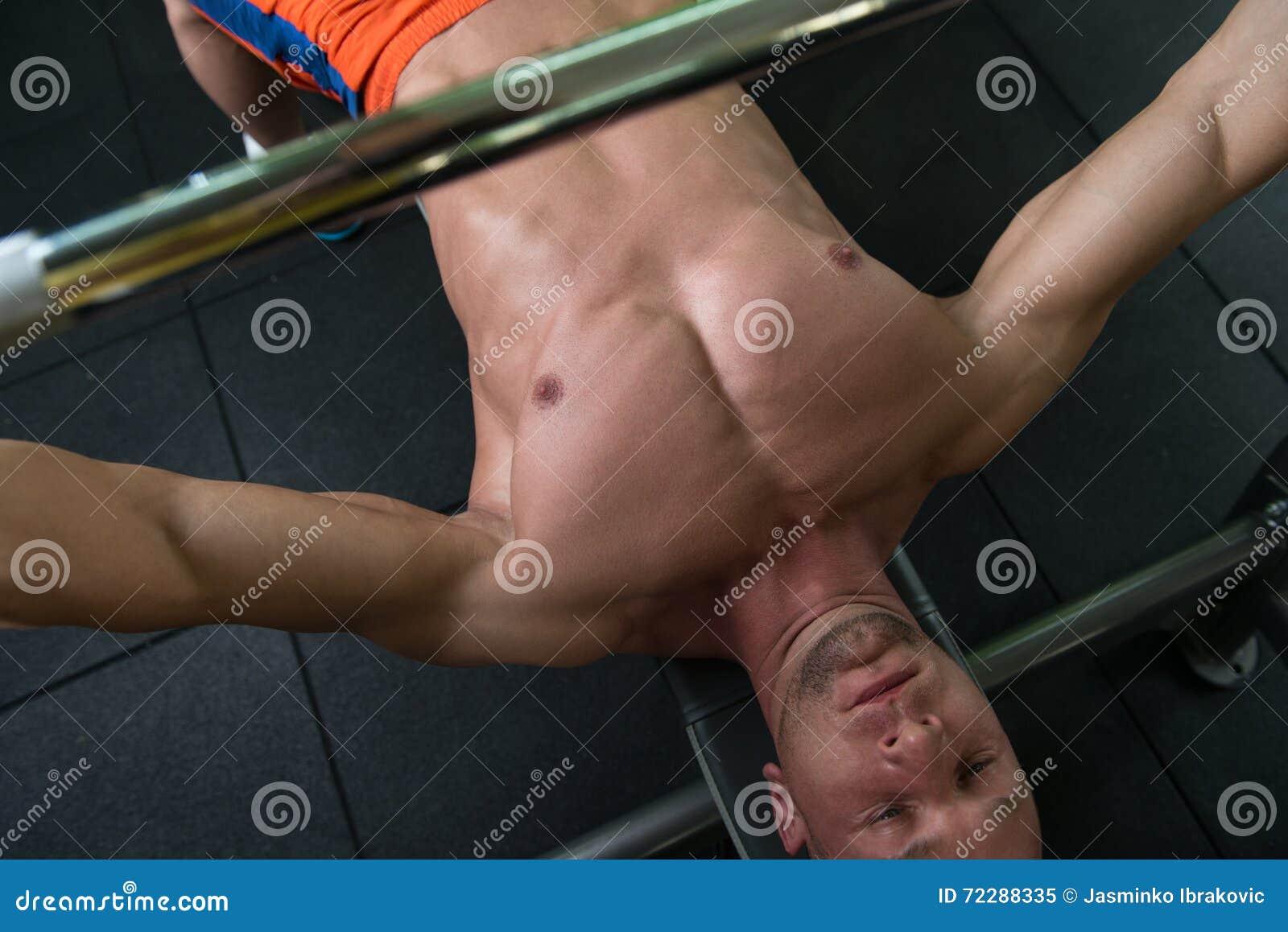 Download Конец разминки жима лёжа вверх Стоковое Изображение - изображение насчитывающей возмужало, bodysuits: 72288335