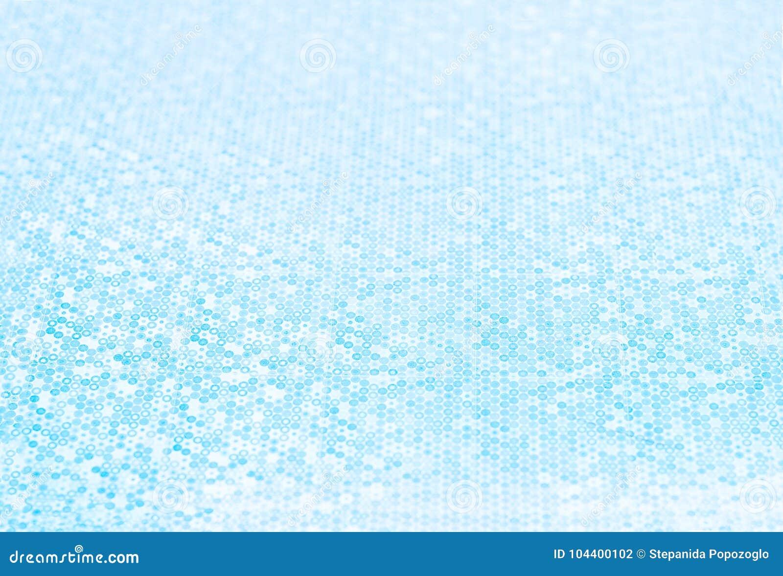 Конспект запачкал голубую предпосылку тона с малой глубиной поля