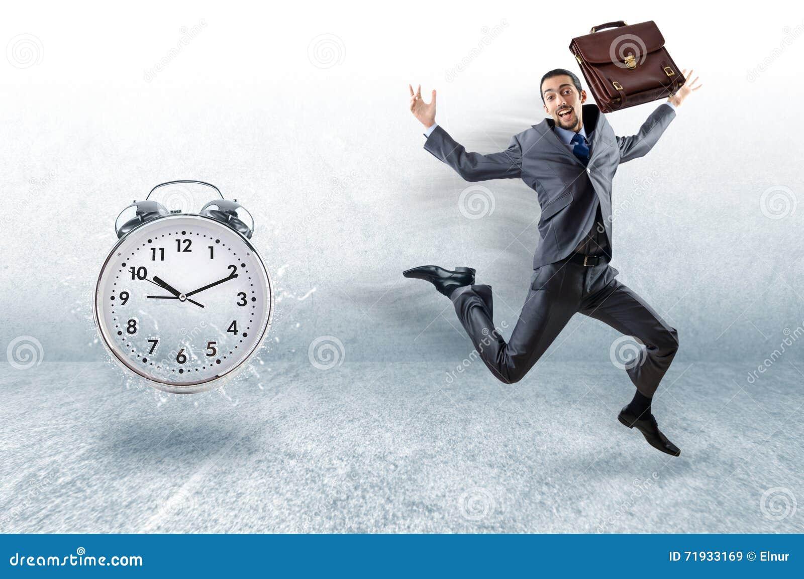 Концепция дела с бизнесменом и часами
