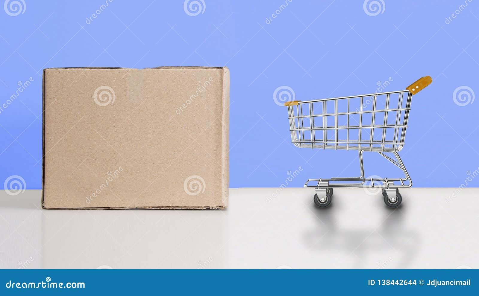 Корзина рядом с картонной коробкой как коммерция и ходя по магазинам концепция пустой космос экземпляра