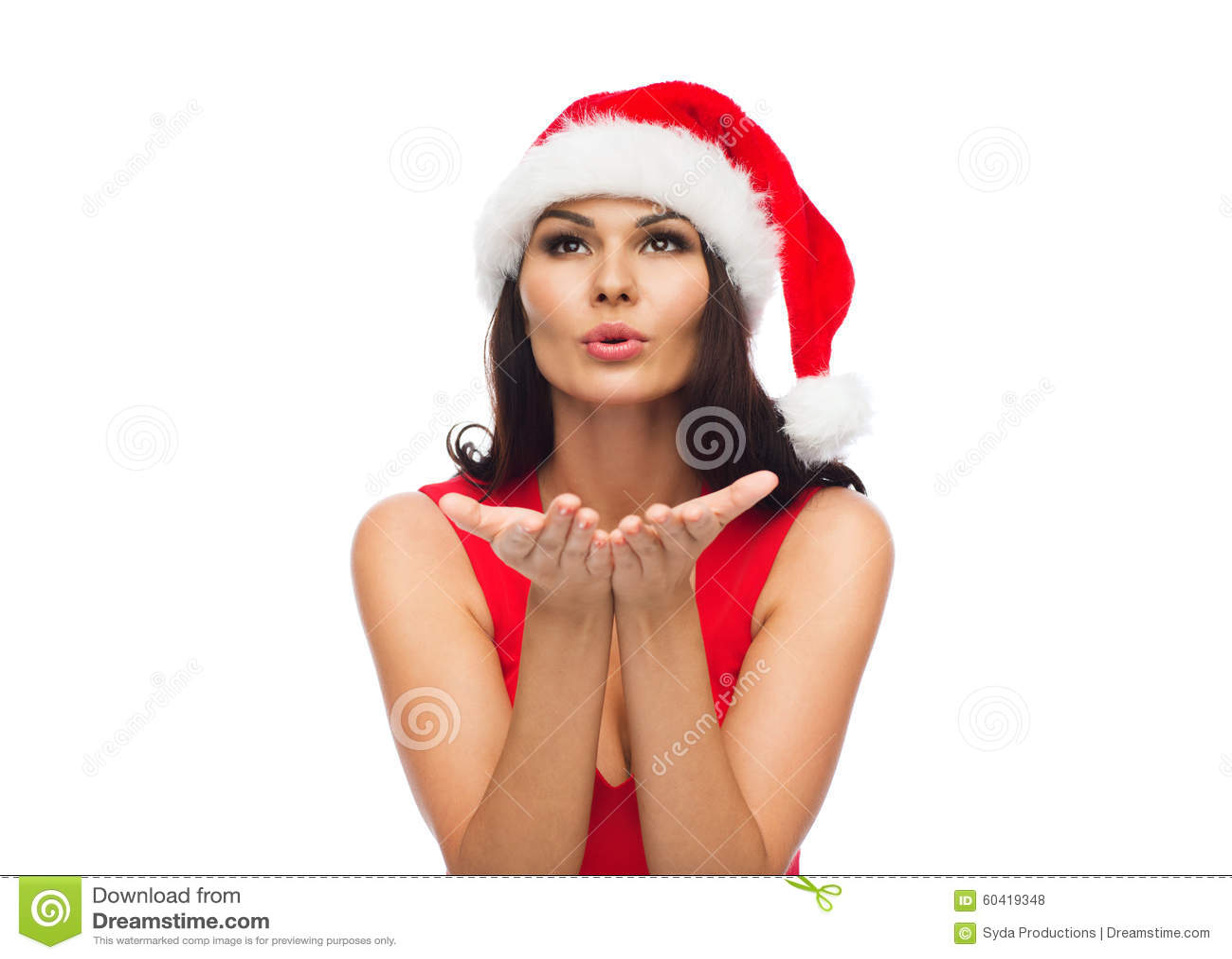 Красивая сексуальная женщина в шляпе santa и красном платье