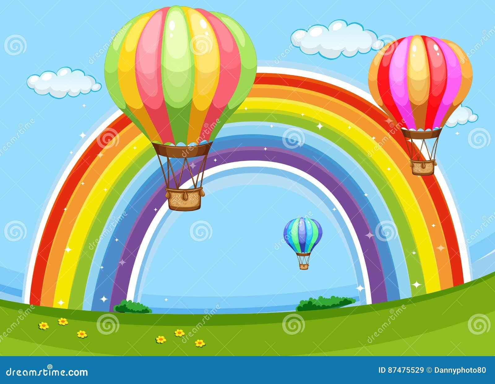 Красочные воздушные шары летая над радугой