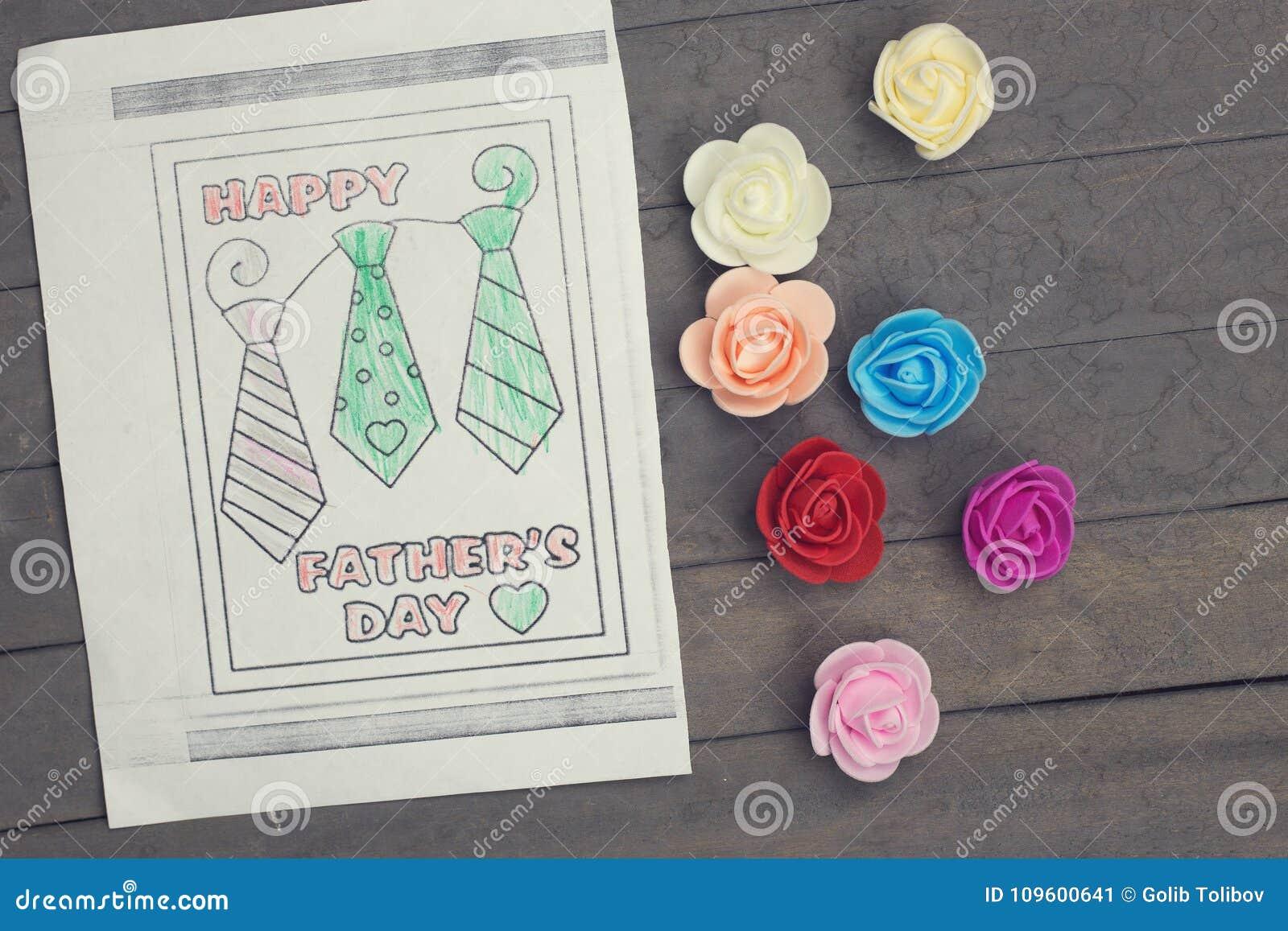Красочные чертеж и цветки Счастливая поздравительная открытка дня отцов сделанная ребенком