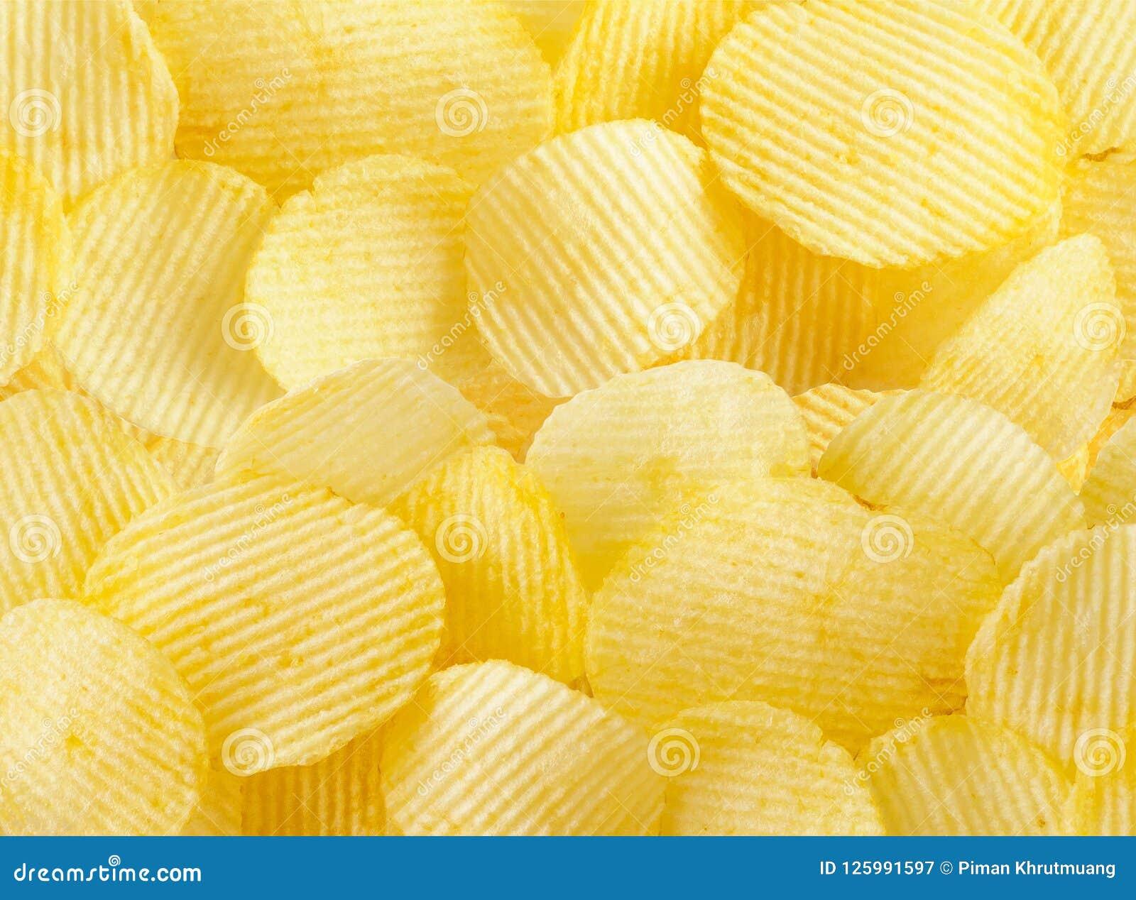 Кудрявая предпосылка текстуры закуски картофельных стружек