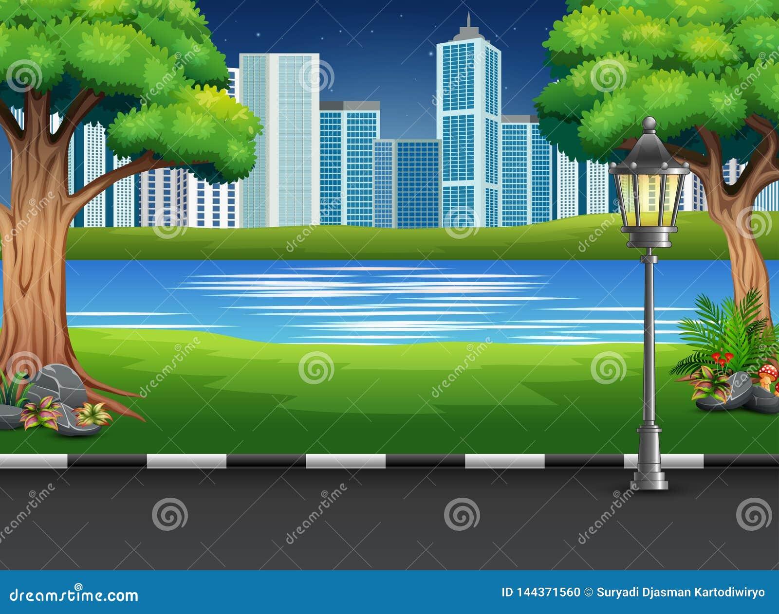Ландшафт парка города с рекой и городской предпосылкой