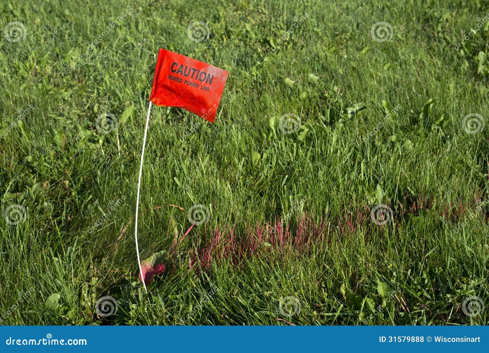Линия электропитания горячей линии землекопа похороненная флагом