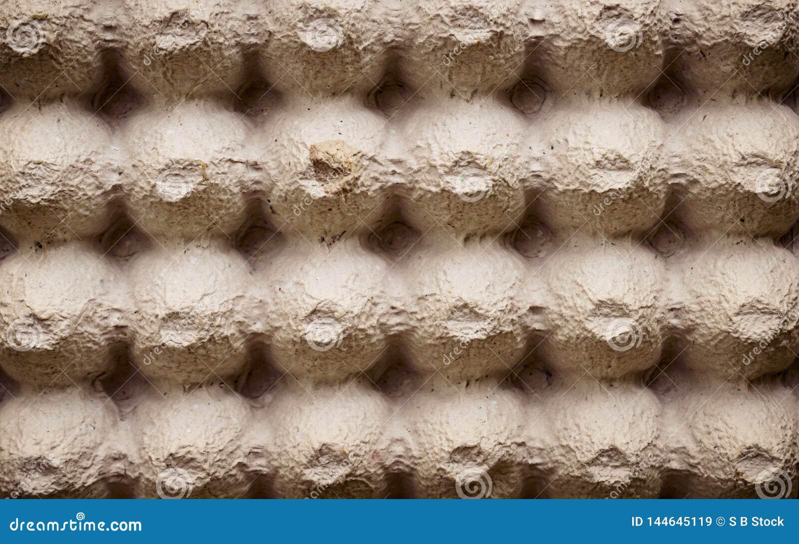 Лист поверхности взгляда сверху пустой коробки клети яйца картона или коробки яя сделал типа коричневого листа пены упаковки цвет