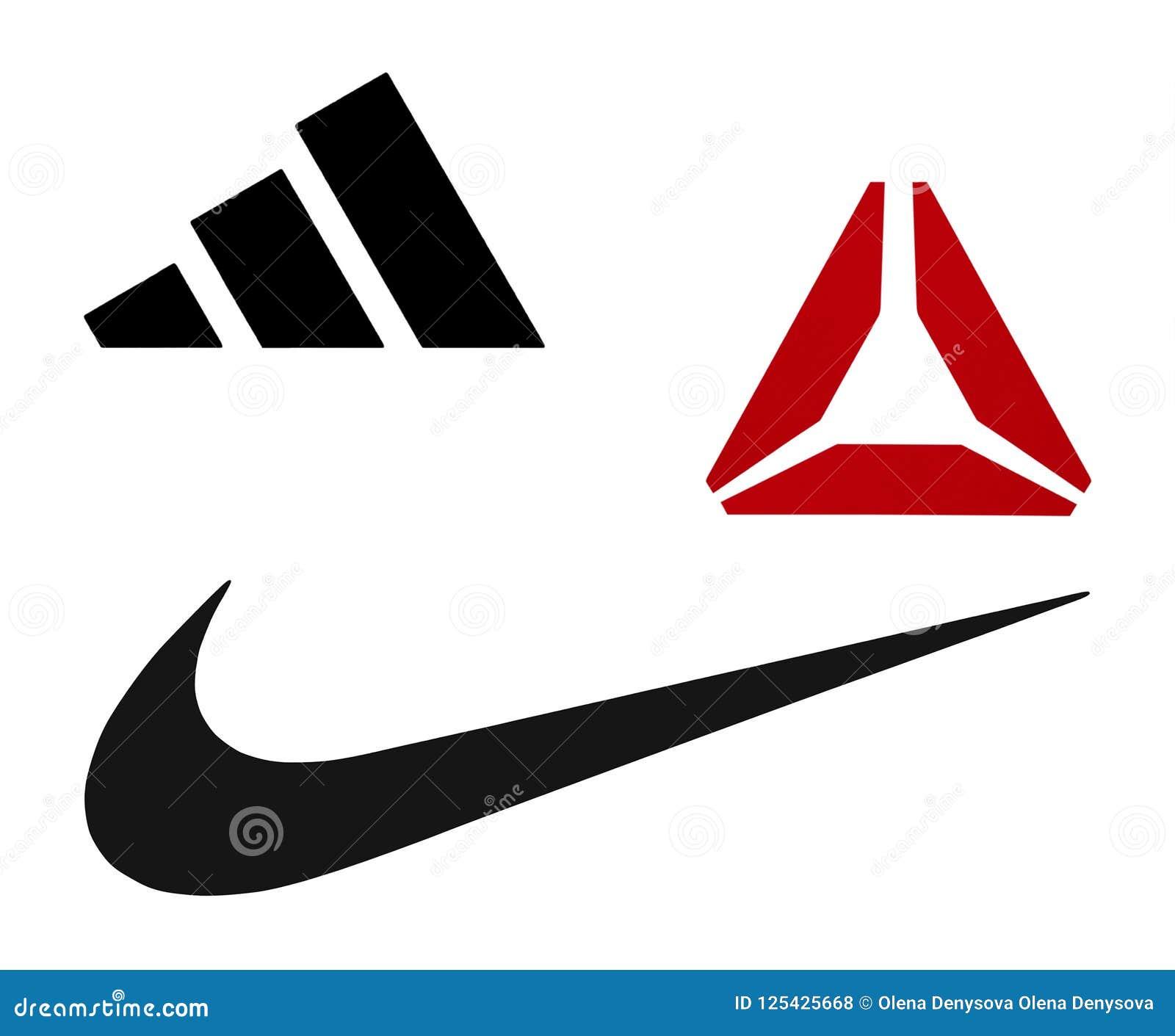 0ec69e81 Киев, Украина - 20-ое сентября 2017: Логотипы Найк, Reebok и Adidas  напечатанные на бумаге и помещенные на белой предпосылке
