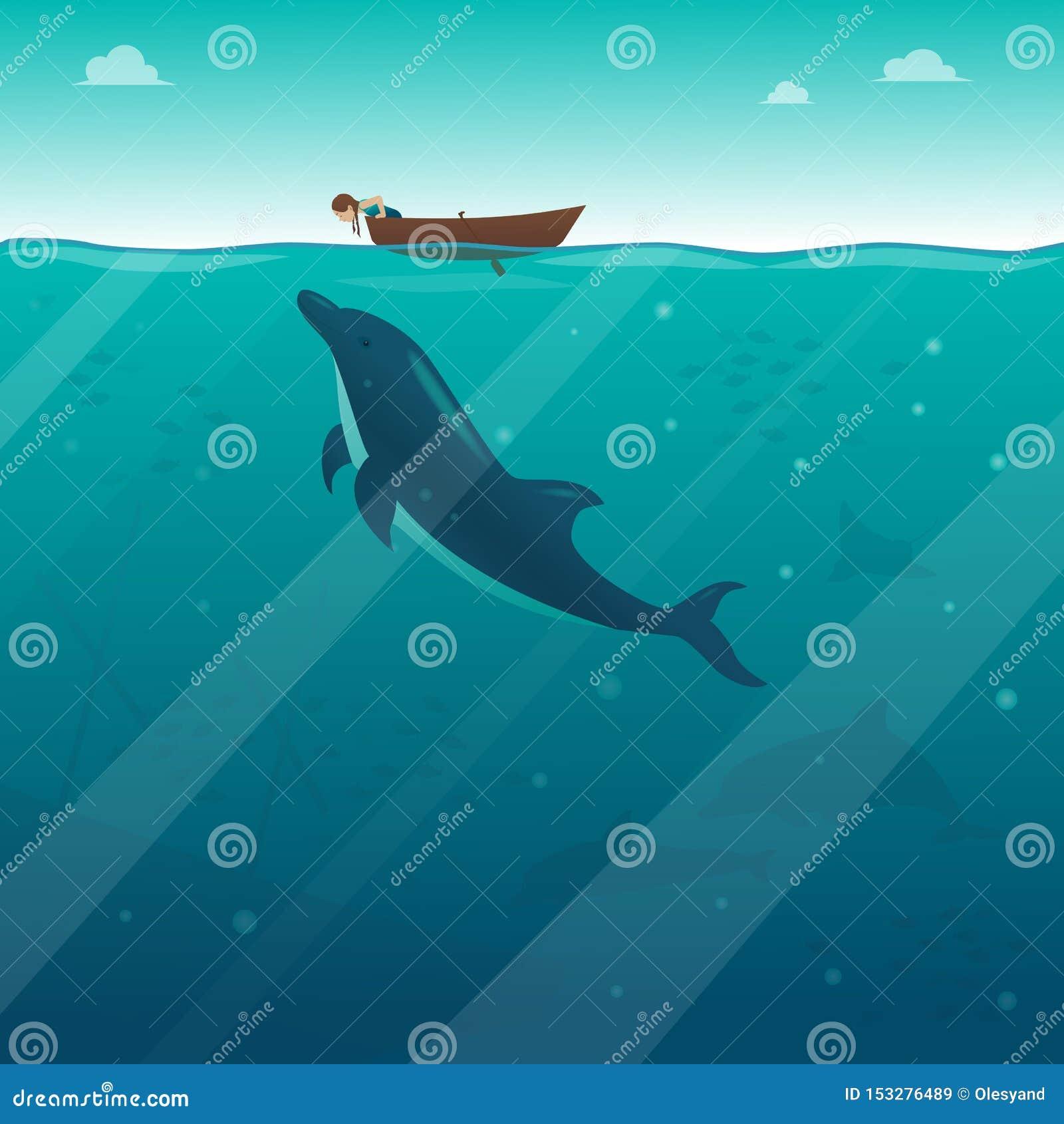 Маленькая девочка в шлюпке смотря в воду на дельфине