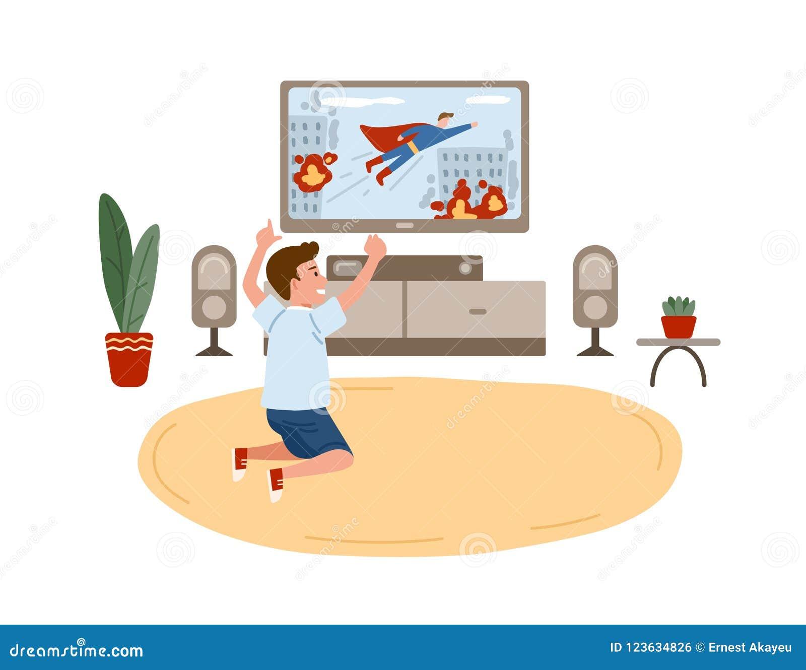 Мальчик сидя на поле и смотря кино супергероя, боевик или телевизионный канал для детей на телевизоре дом