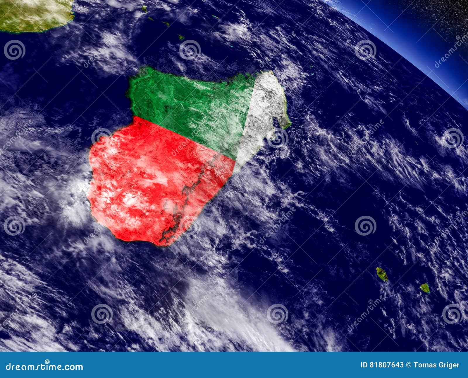 Мадагаскар с врезанным флагом на земле