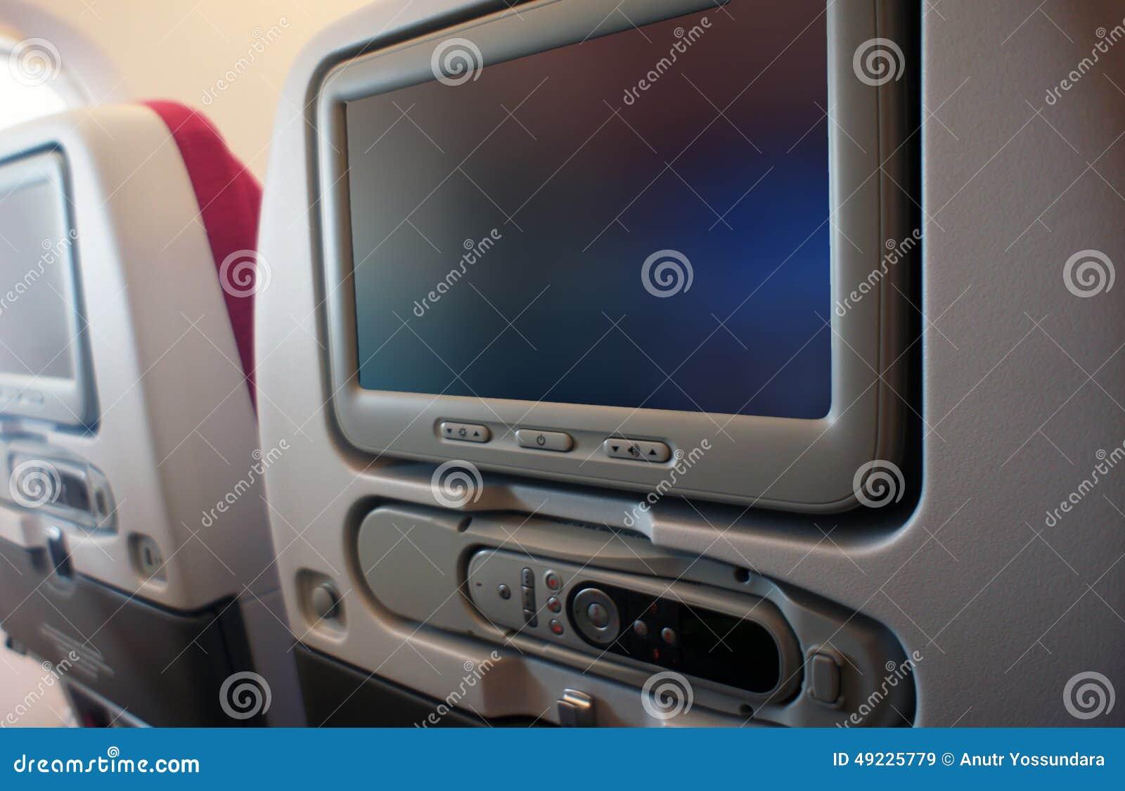 Место класса авиакомпании экономическое с ТВ экрана касания