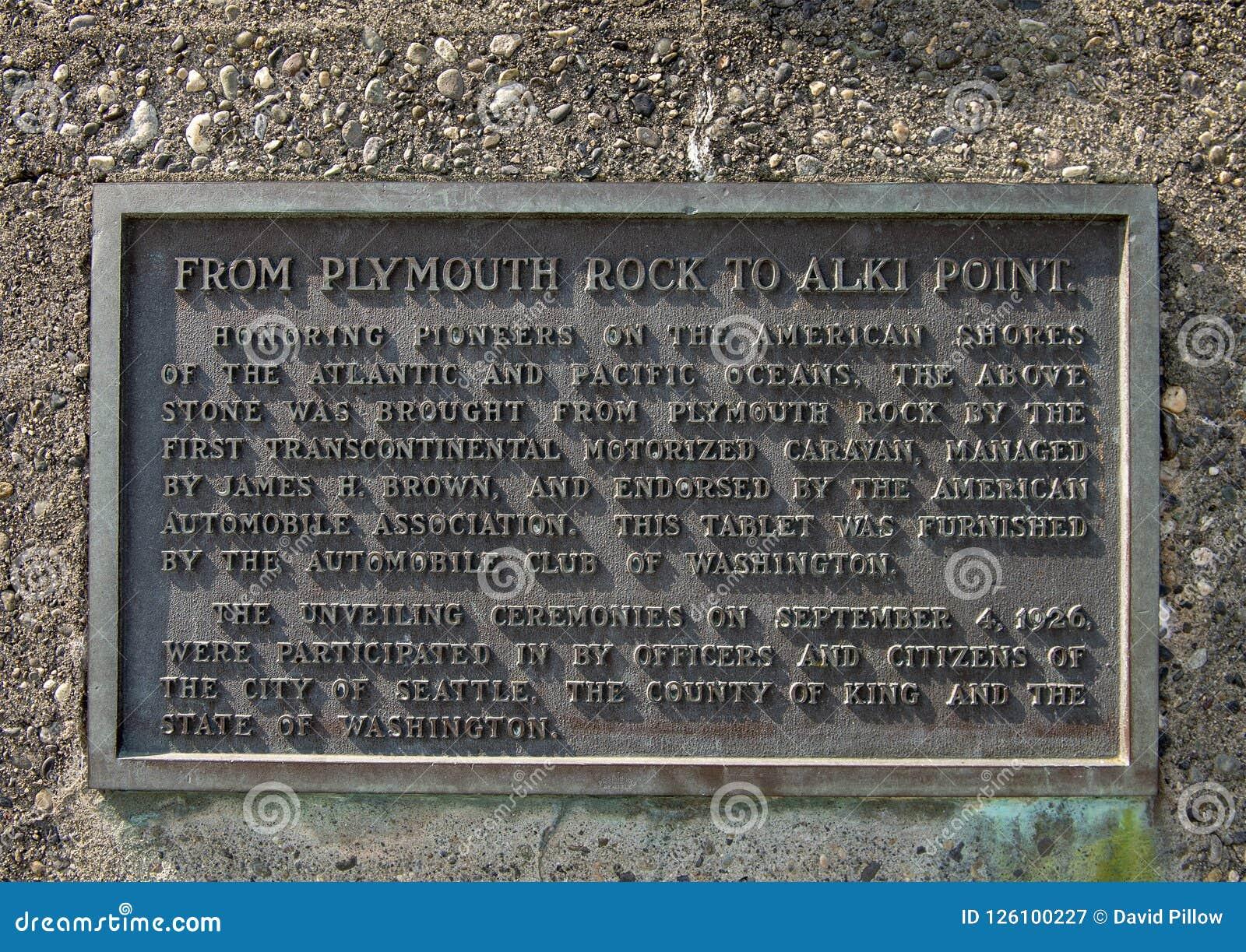 Металлическая пластинка информации на месте рождения памятника Сиэтл, пляжа Alki, Сиэтл, Вашингтона