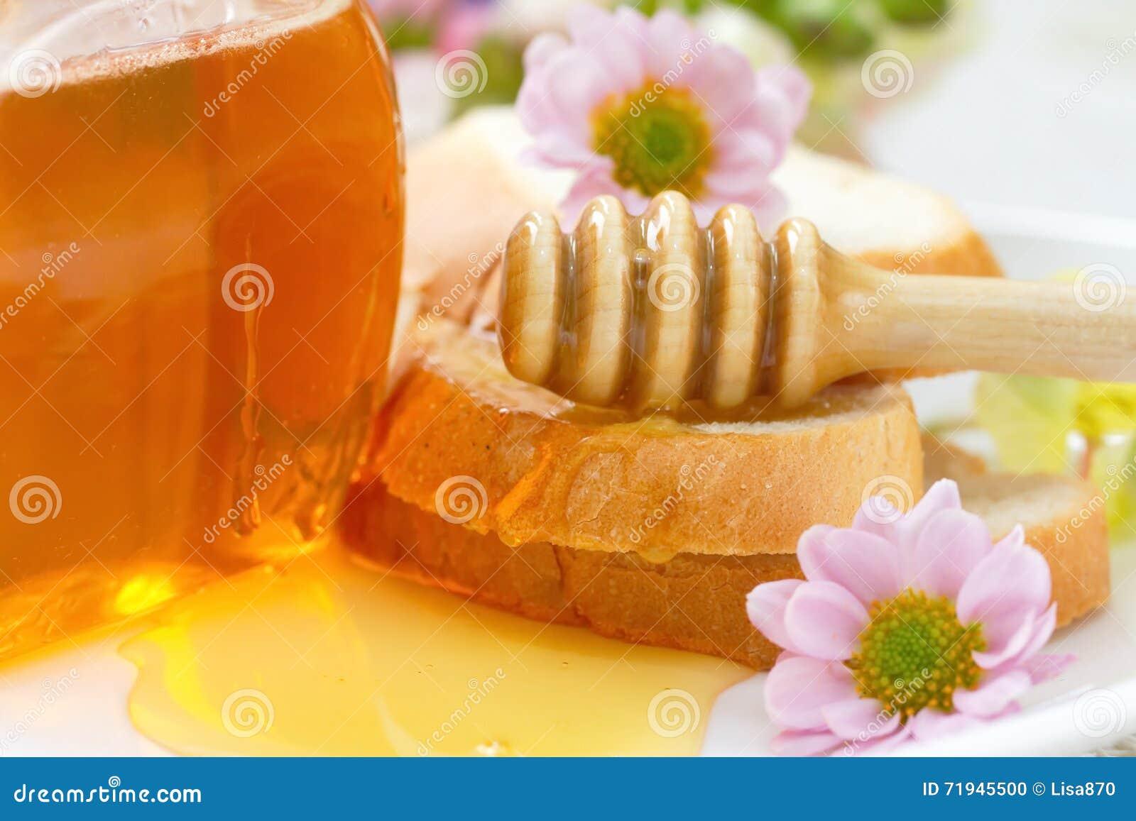 Мед цветка и хлеб пшеницы