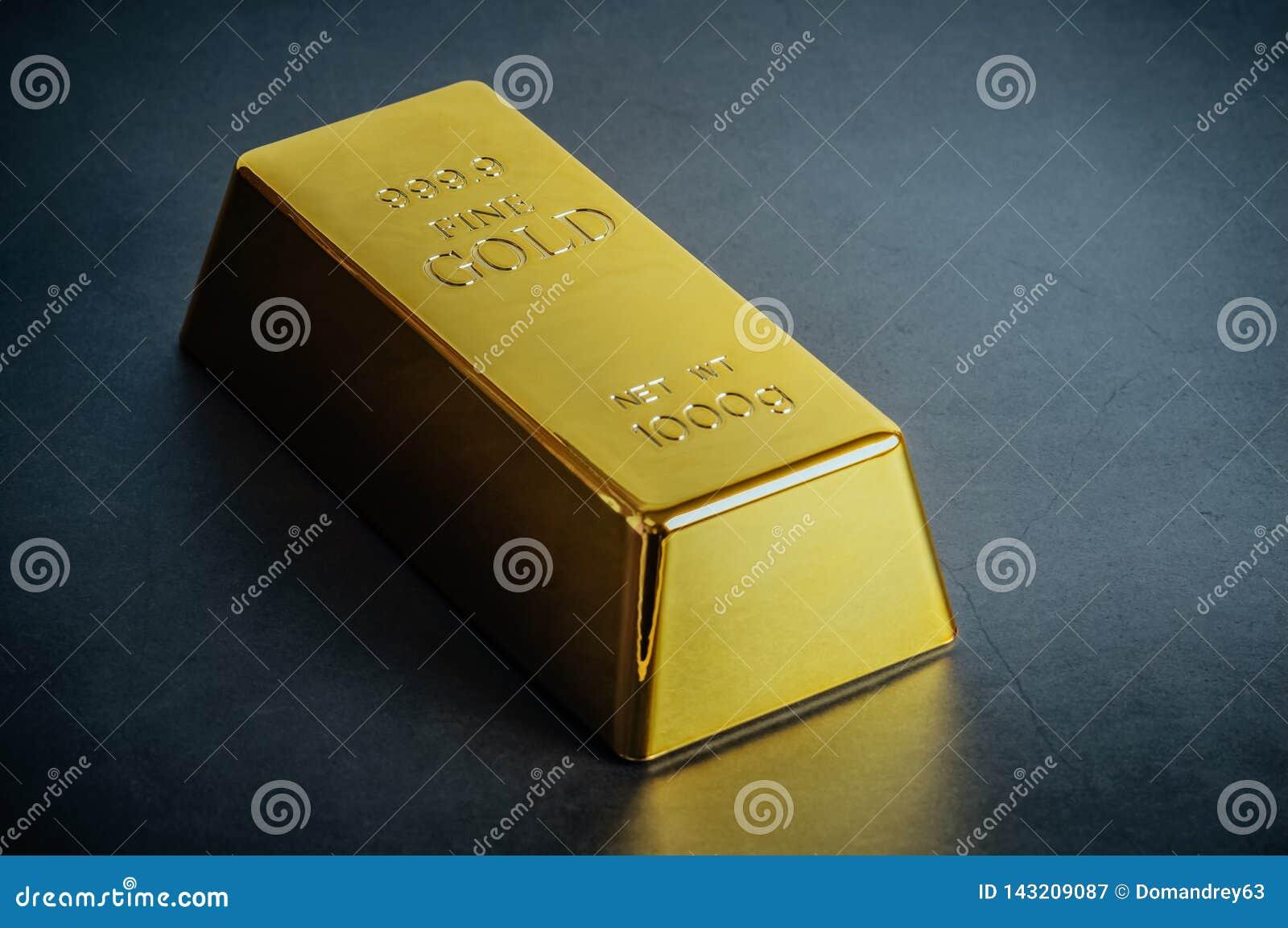 Миллиард слитка бара золота на голубой предпосылке Размещено раскосно