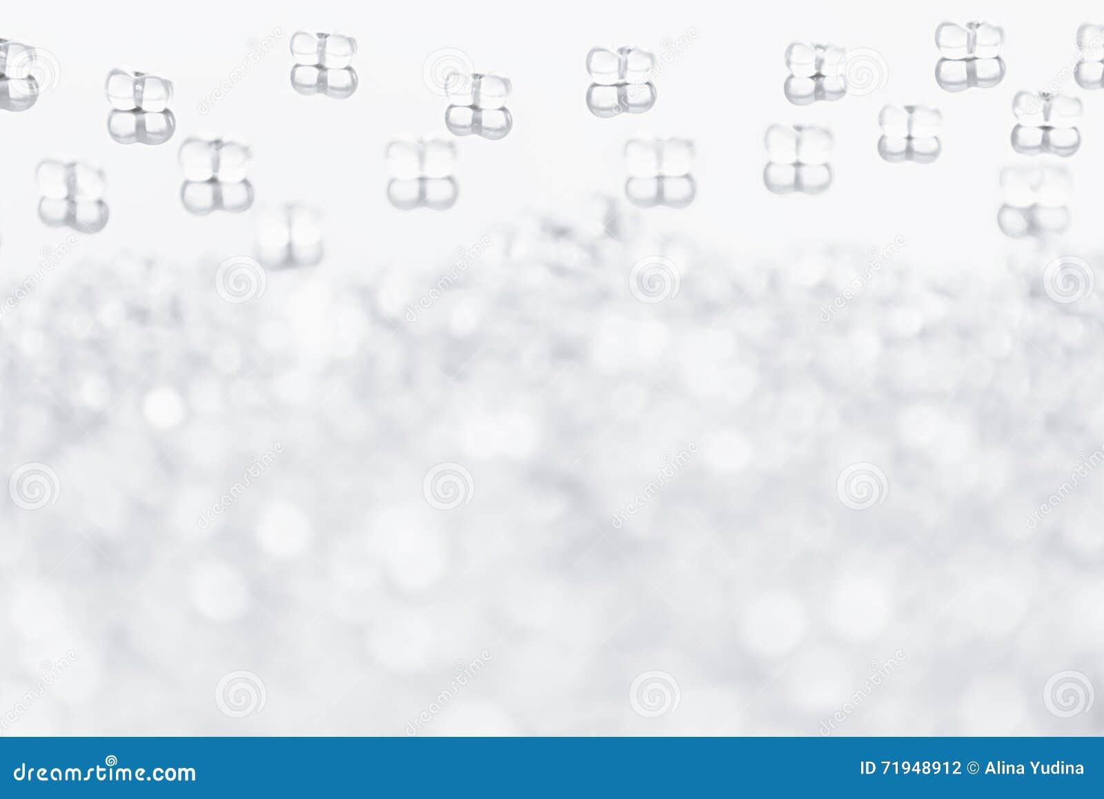 Минималистская абстрактная светлая предпосылка с прозрачными стеклянными частицами