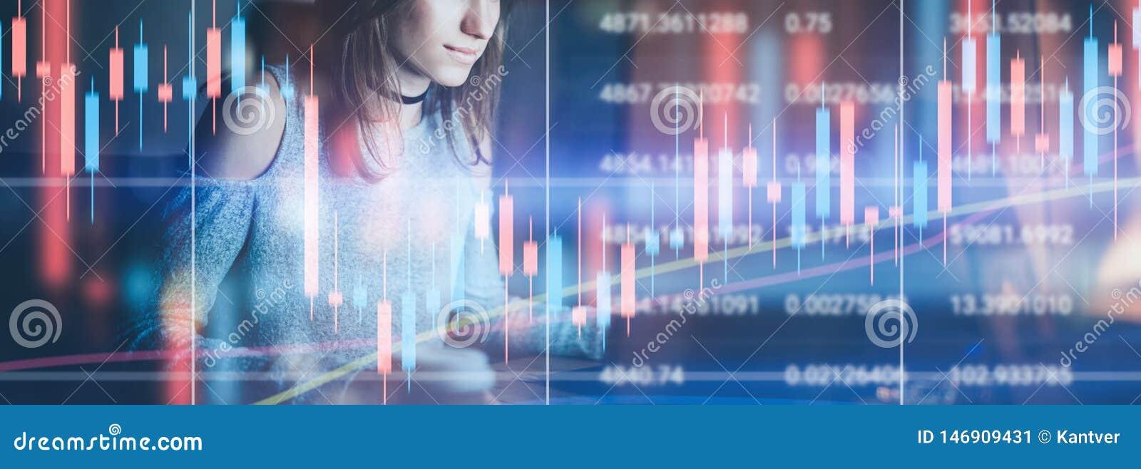 Молодая женская модель работая вечером современный офис Техническая диаграмма цены и диаграмма индикатора, красных и зеленых подс