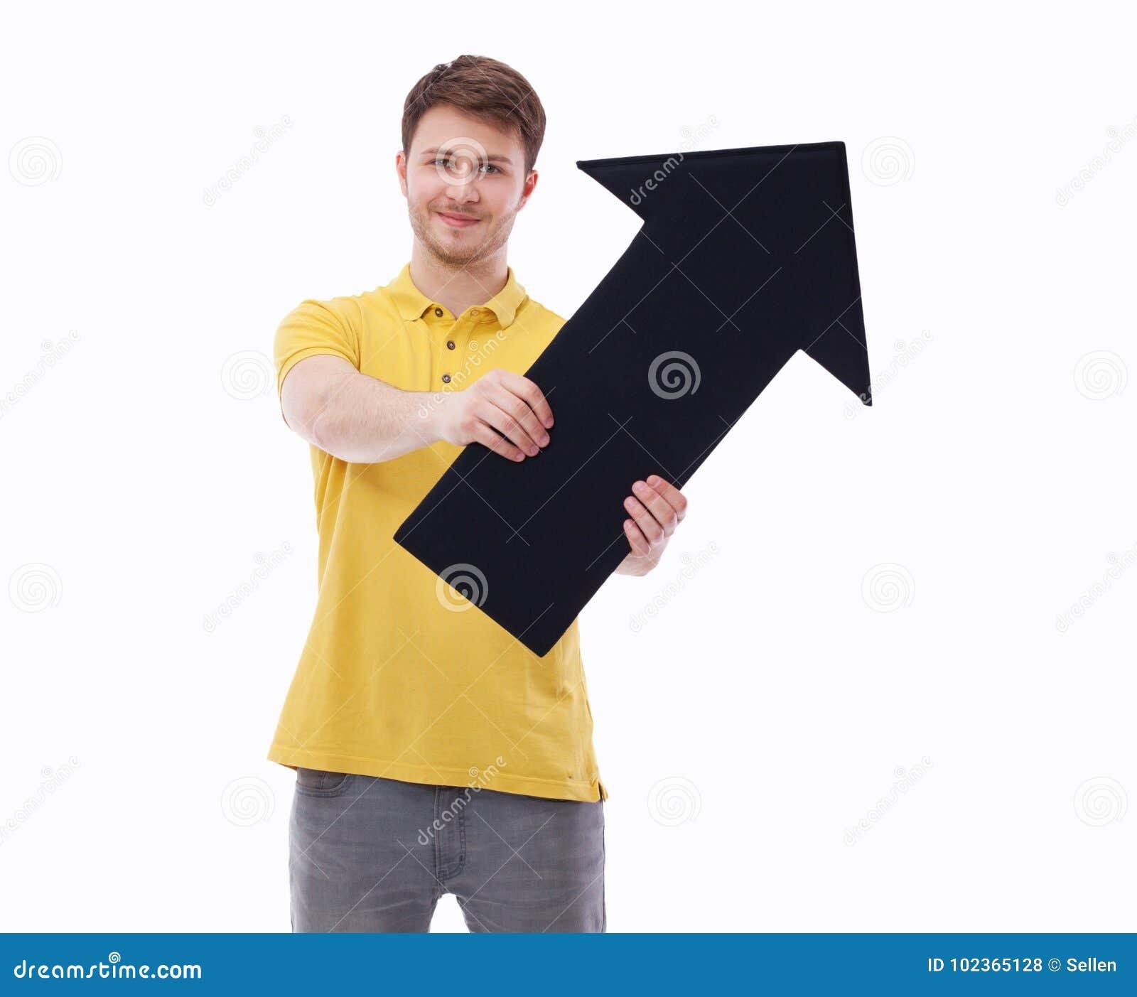 Молодой усмехаясь человек держа пустой указатель, изолированный на белой предпосылке