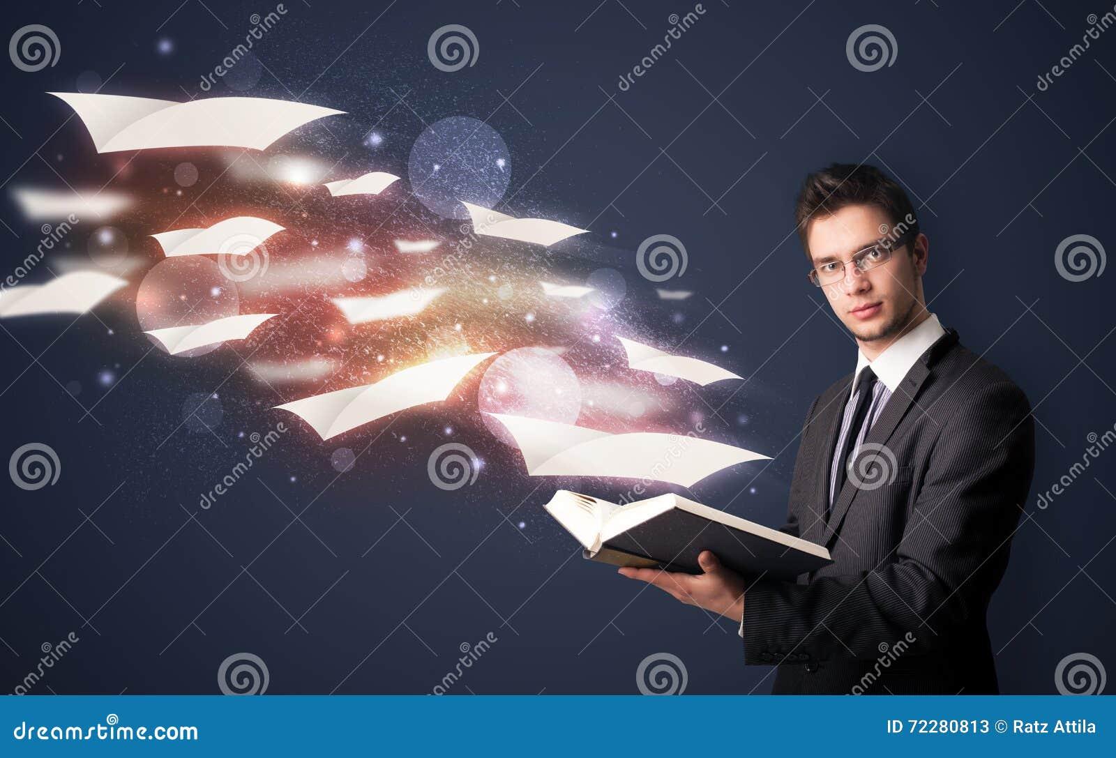 Download Молодой парень читая книгу при листы летания приходя из Bo Стоковое Изображение - изображение насчитывающей болван, муха: 72280813