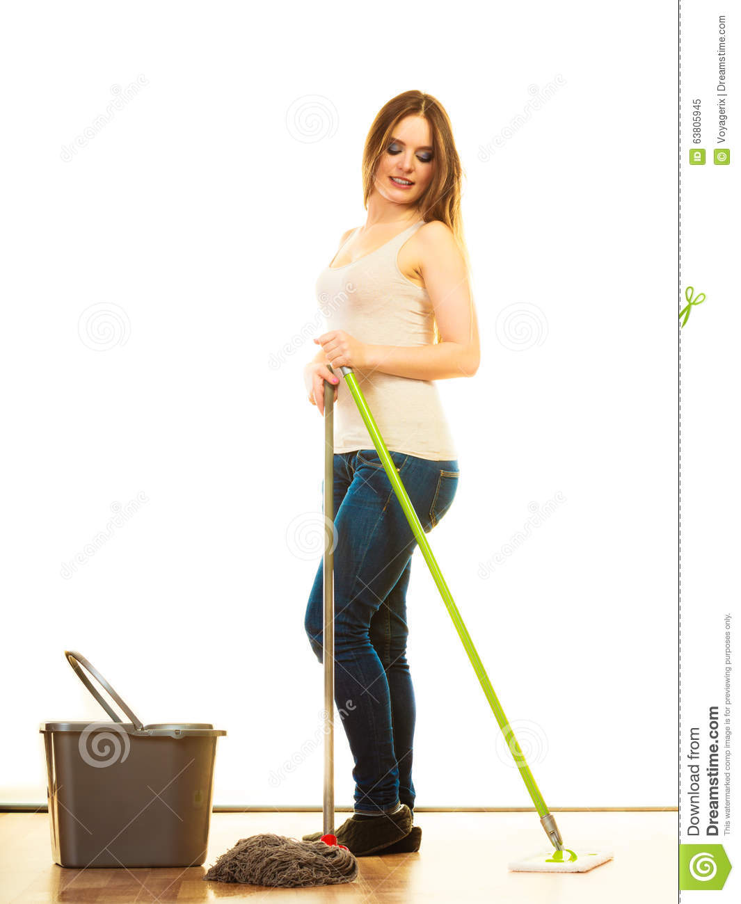 Sexy woman sweeping the floor with an old fashioned witch type broom stock photo