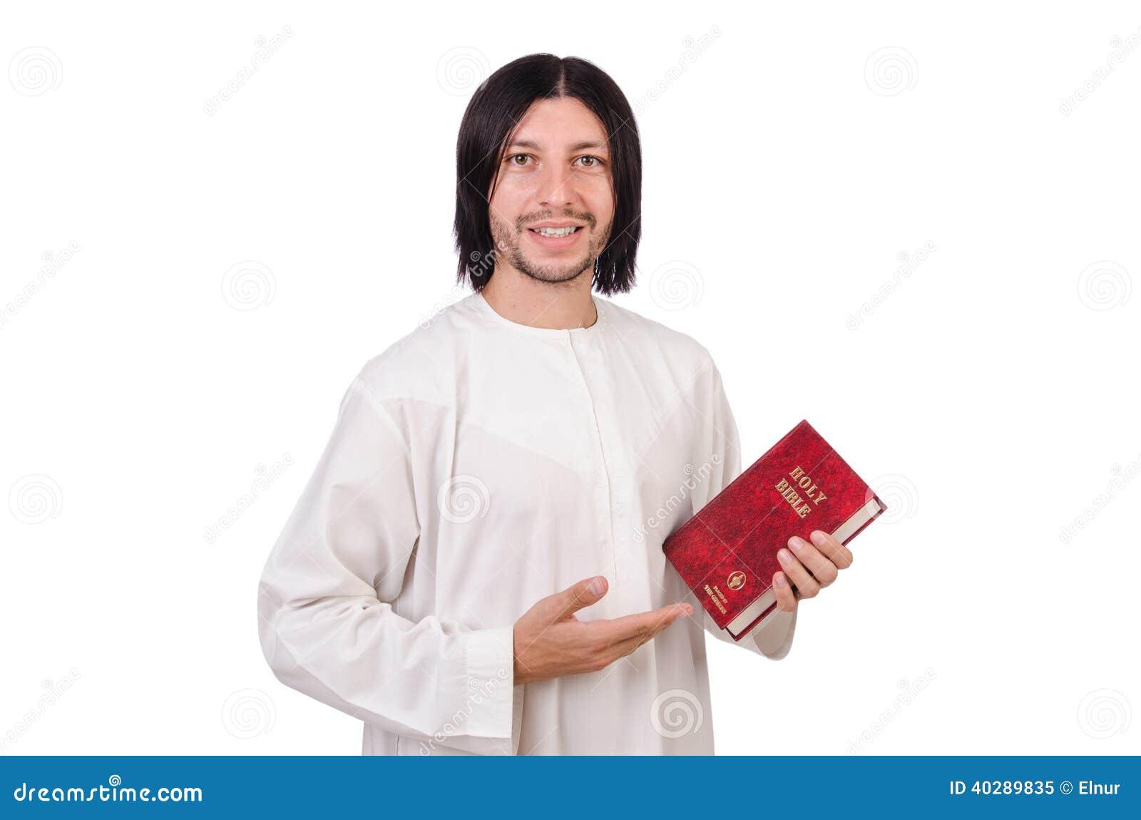 Молодой священник с библией