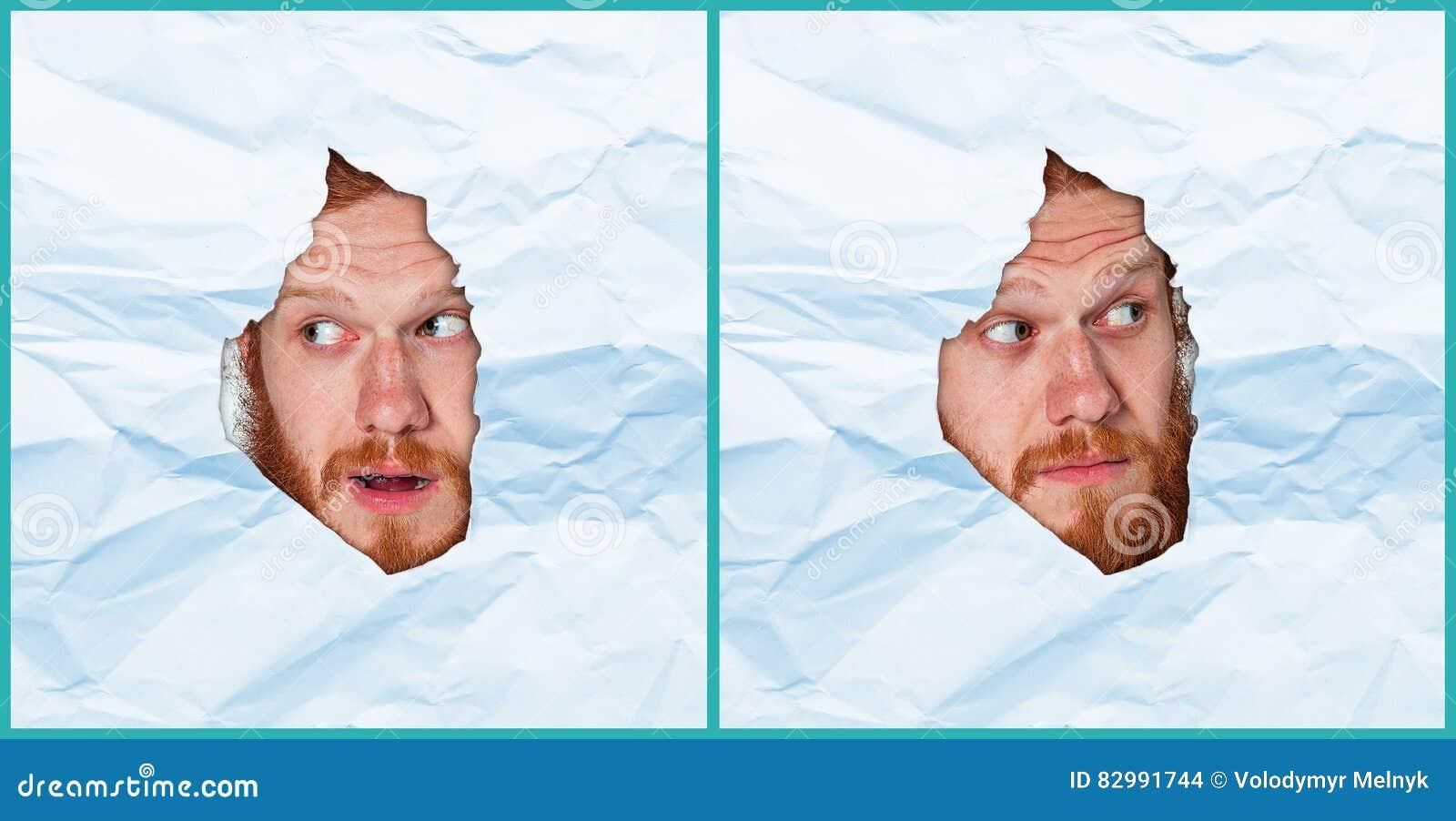 Молодой человек смотря через бумажный сулой