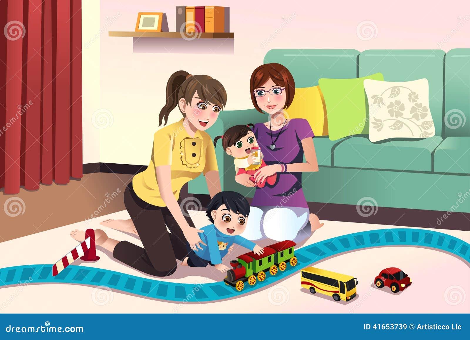 Молодые лесбосские родители играя с их детьми