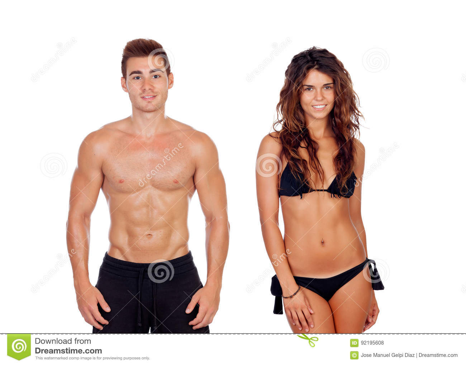 Молодые пары показывая их совершенные тела