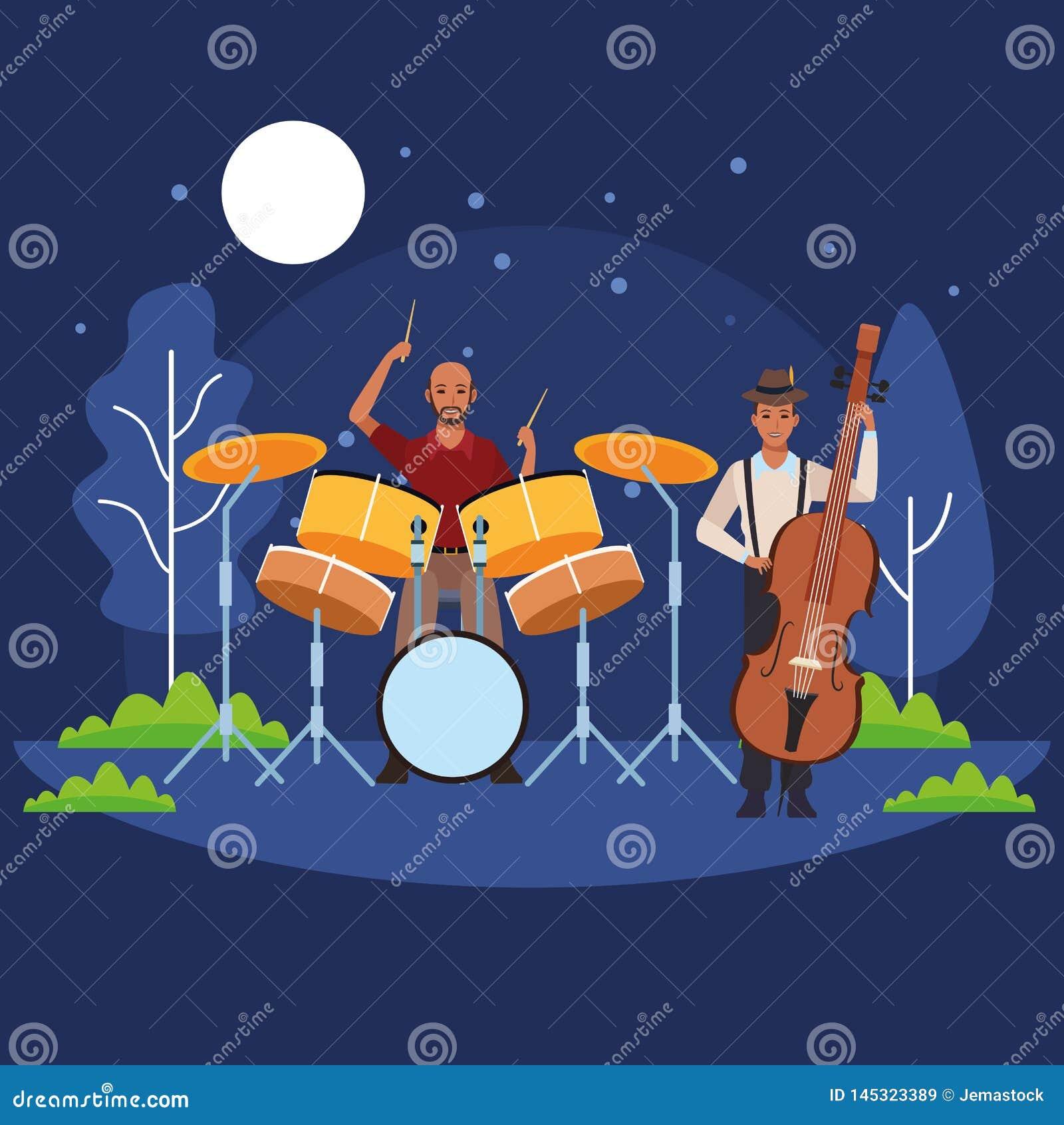 Музыкант играя баса и барабанчиков