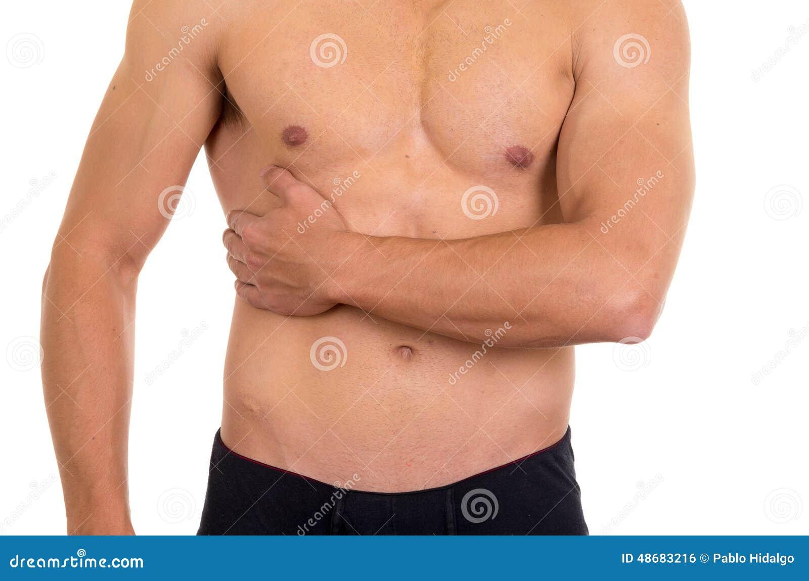 Мышечный без рубашки человек с правой болью брюшка