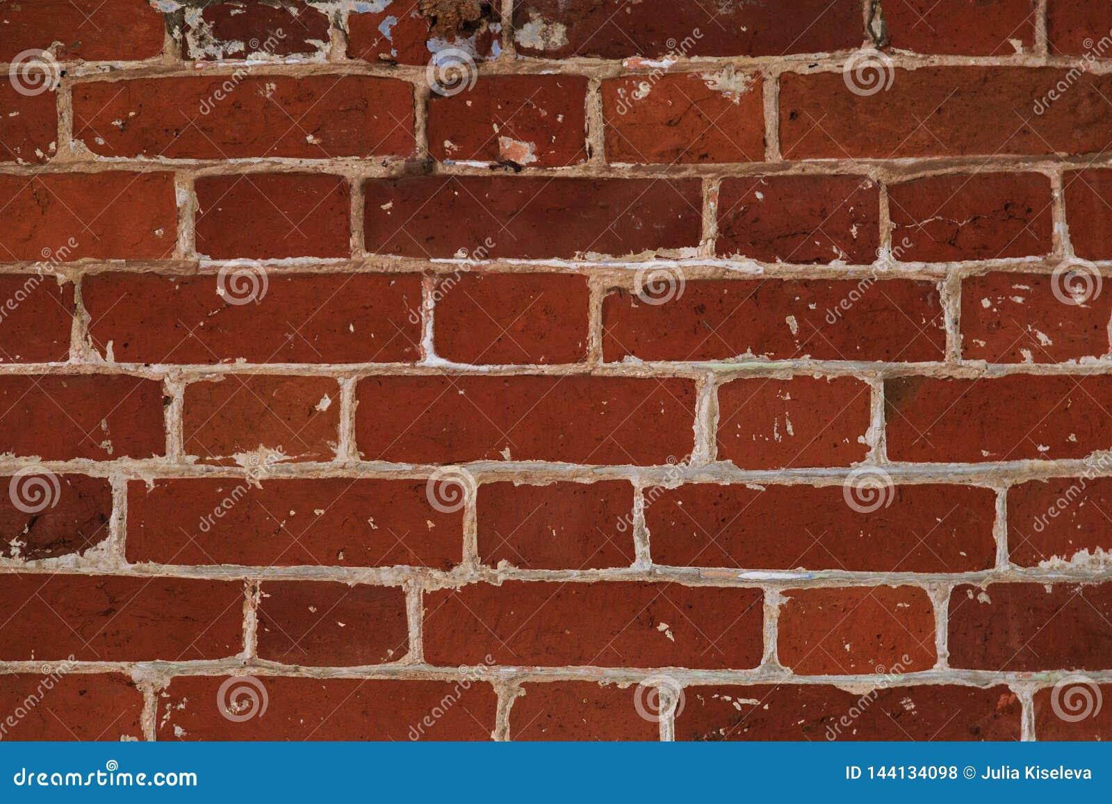 Необыкновенный masonry красных кирпичей, старая каменная текстура