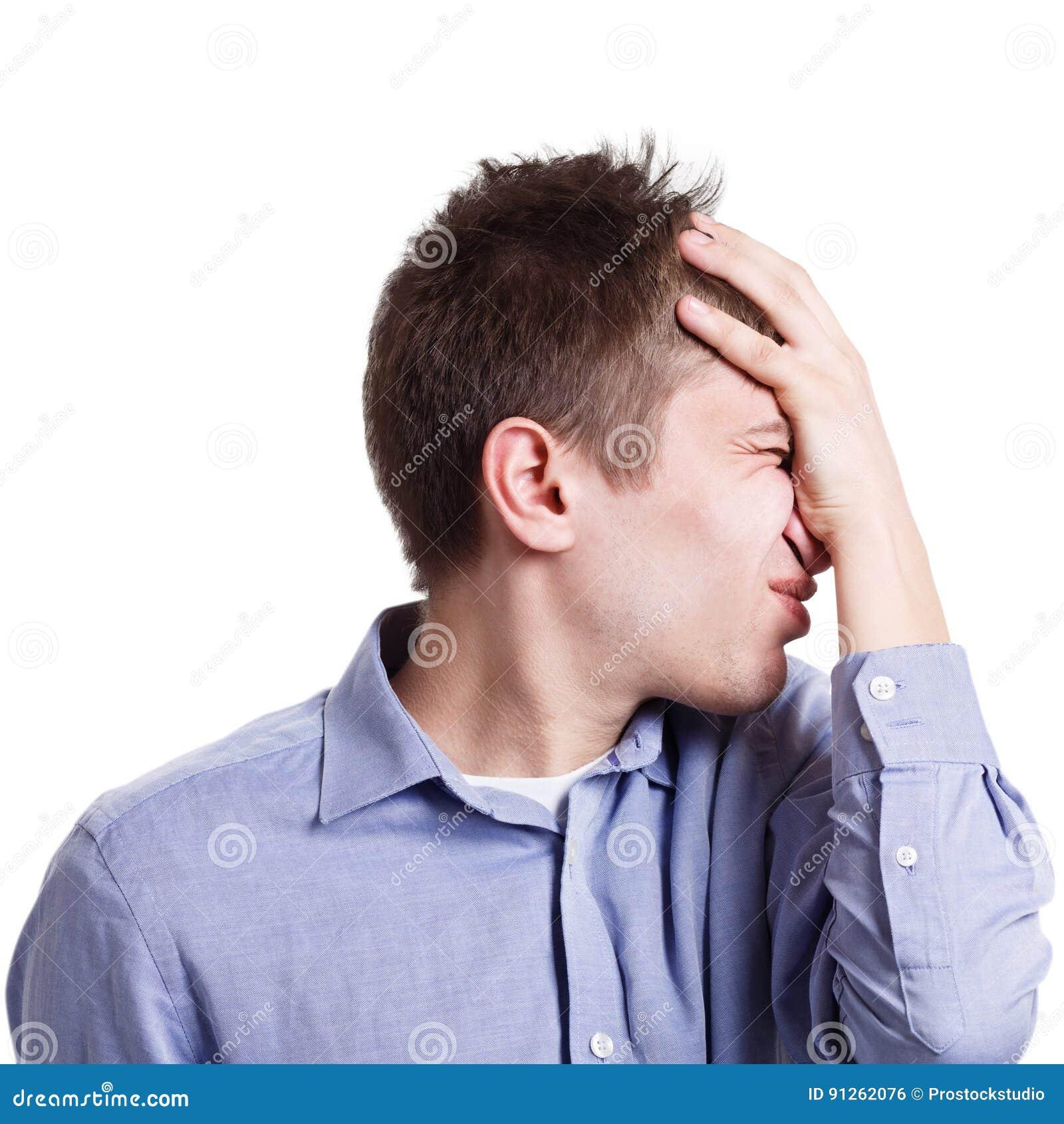 Неудачное facepalm человека, отрицательная эмоция, изолированная на белизне