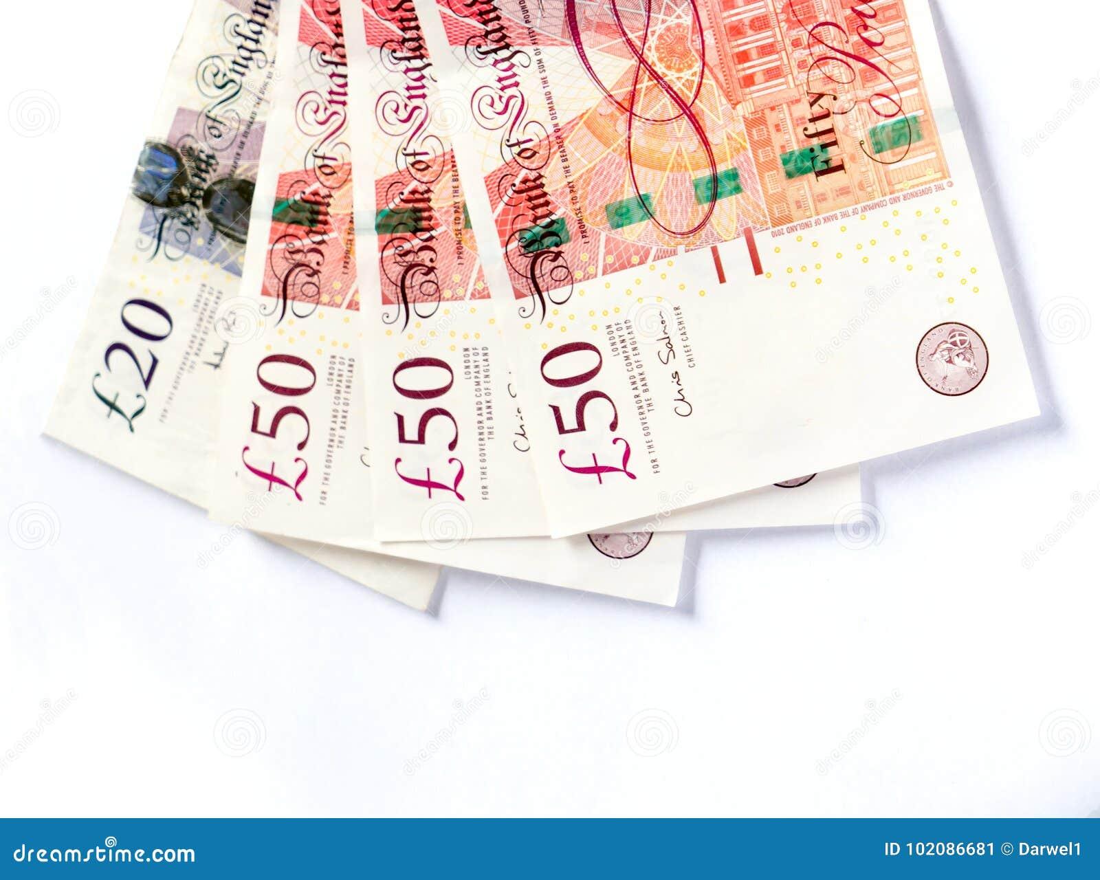 Новые британцы 50 и 20 фунтов изолированных на белой предпосылке