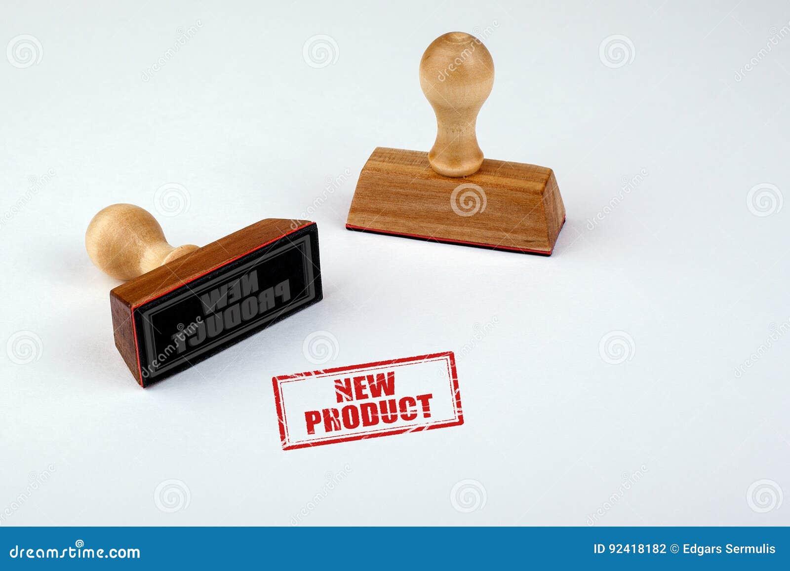 новый продукт Резиновый Stamper при деревянная ручка изолированная на белой предпосылке