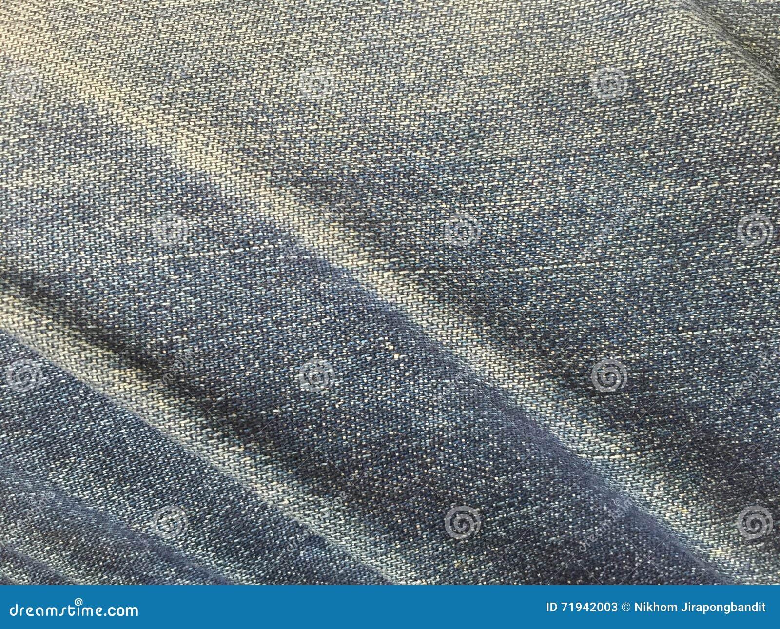 Обреченная ткань джинсов