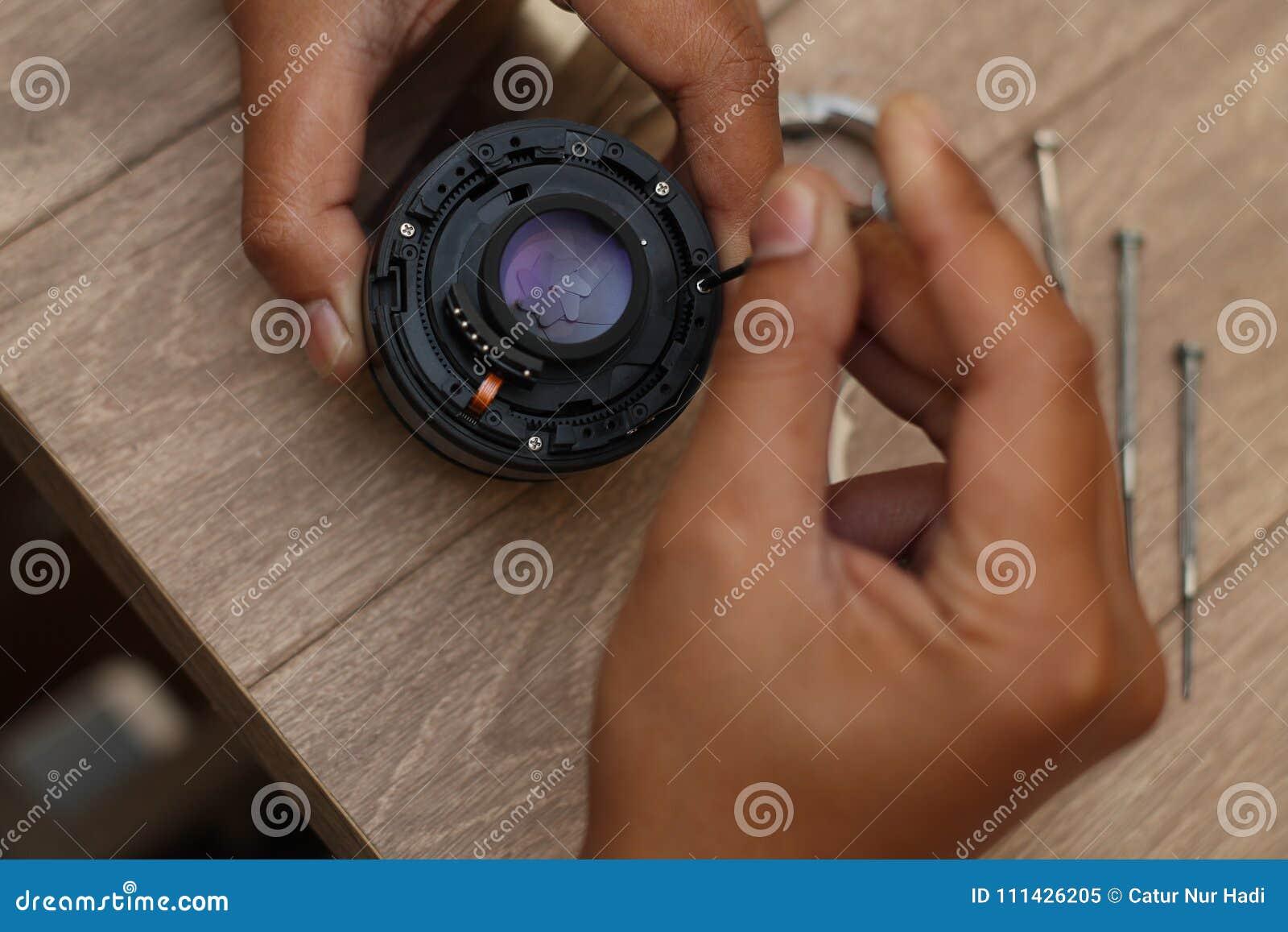 Объектив фотоаппарата починки, версия 4