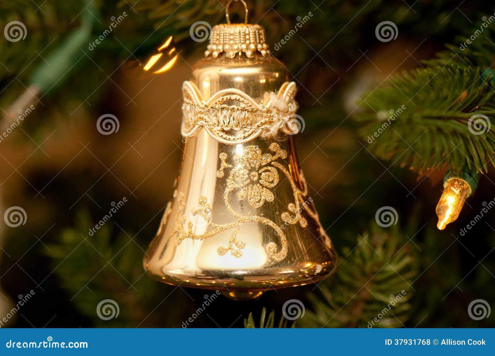 Орнамент рождества колокола золота форменный