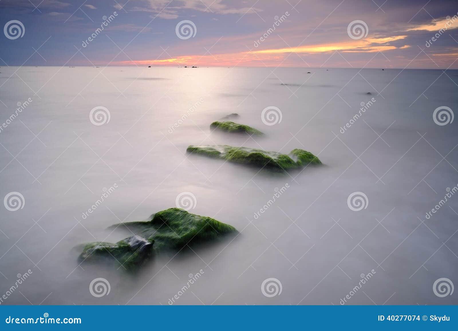 Остров Labuan захода солнца