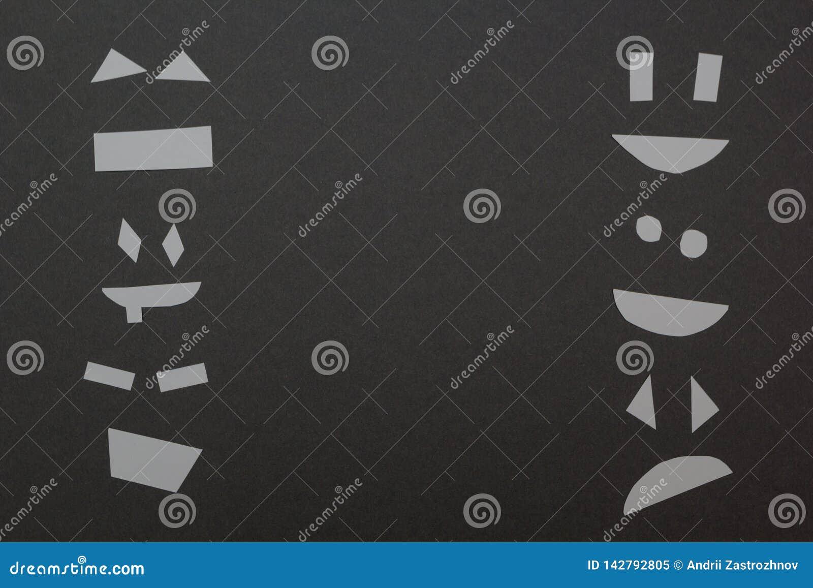 Отрезанные края стороны бумаги рамки на серой предпосылке