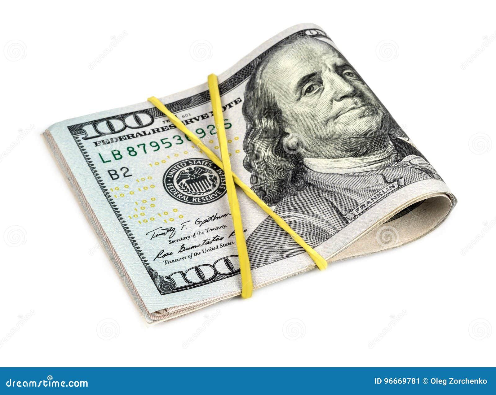 Перевязанные доллары на белой предпосылке