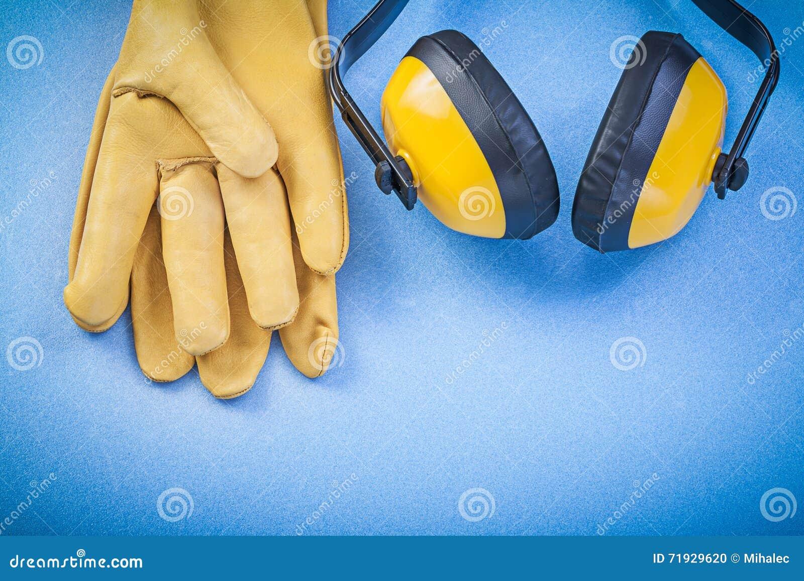 Перчатки безопасности протекторов уха на голубой конструкции предпосылки жульничают