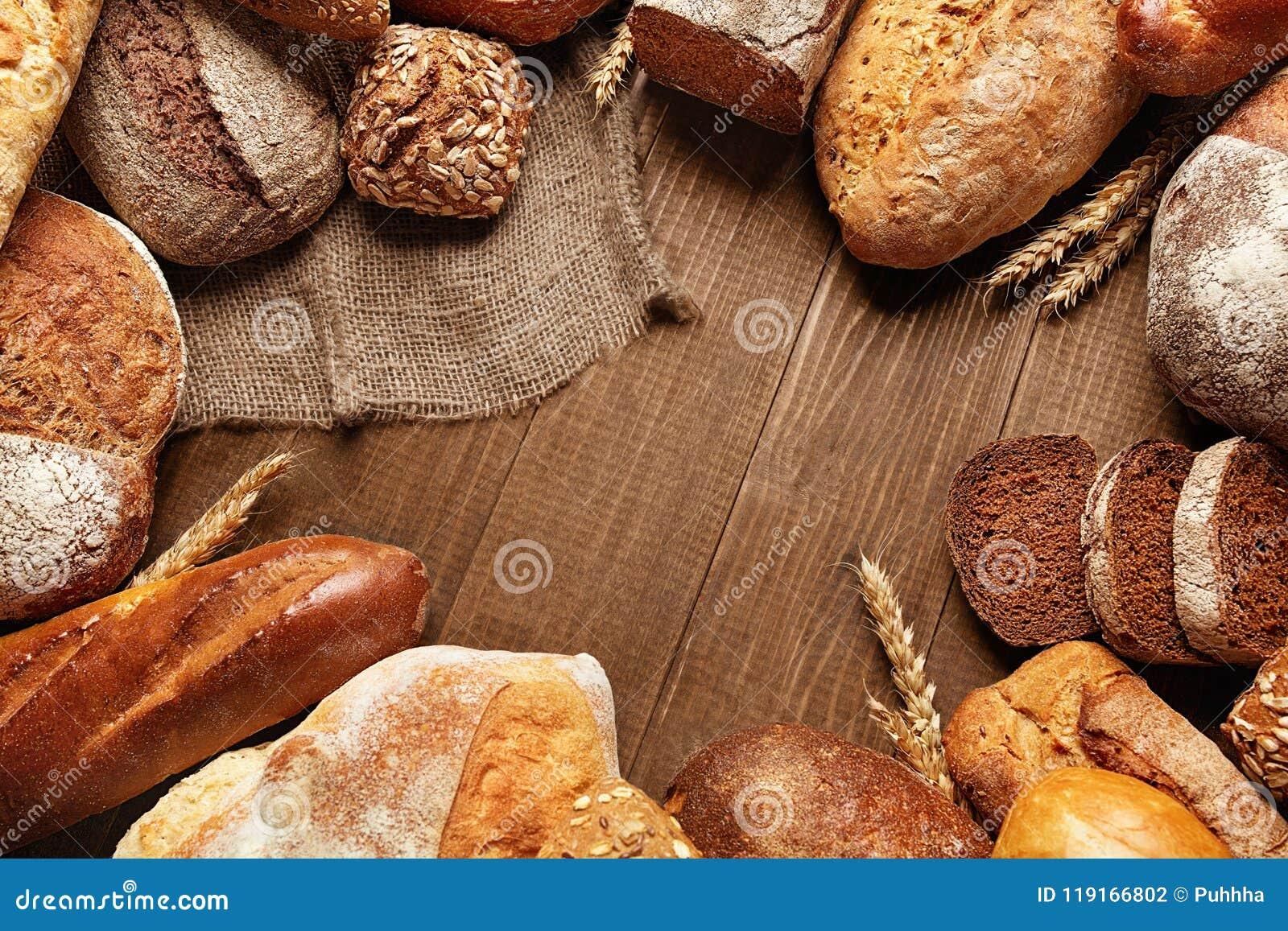 Питание Хлеб и хлебопекарня на деревянной предпосылке